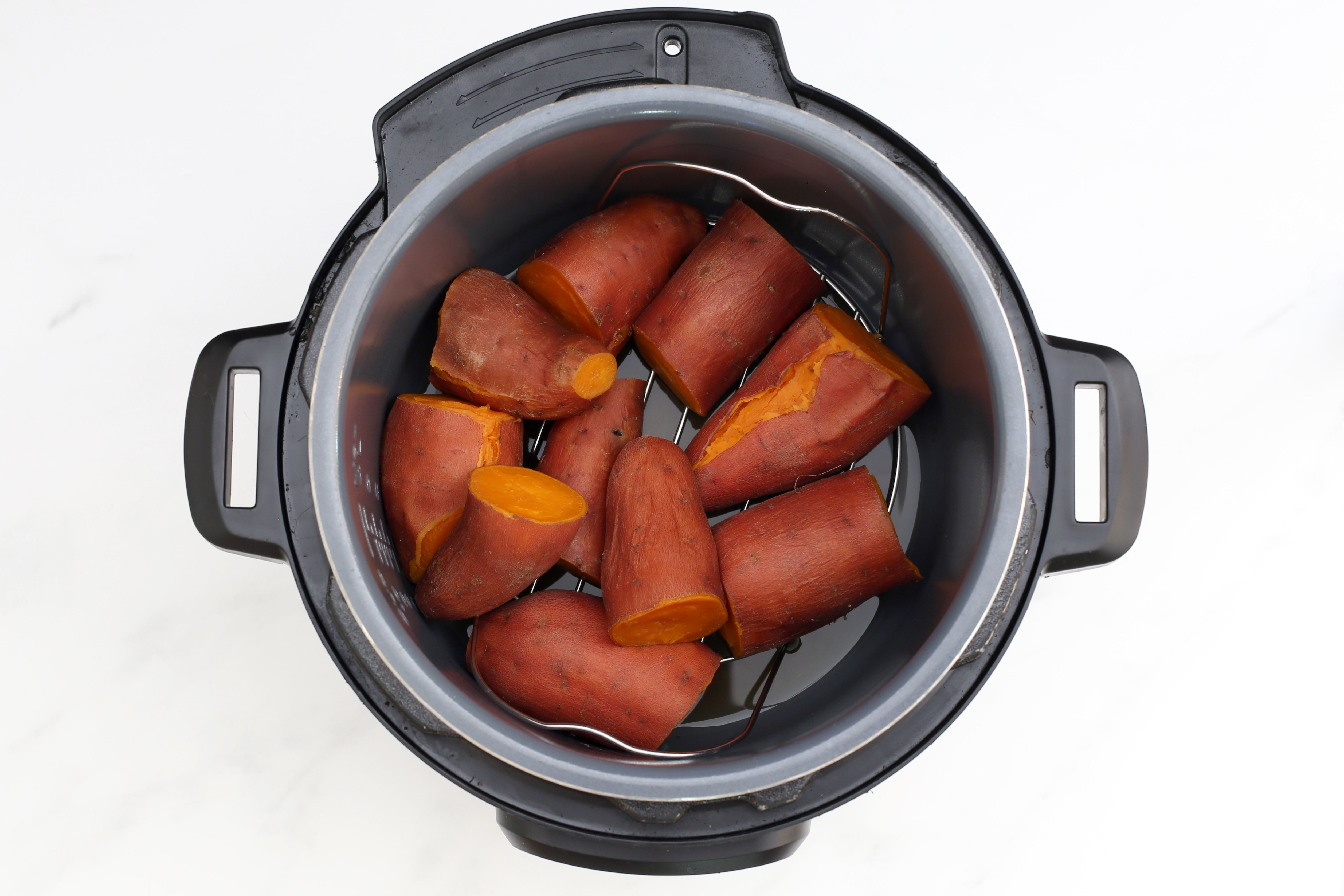 Place the sweet potatoes in the Instant Pot.