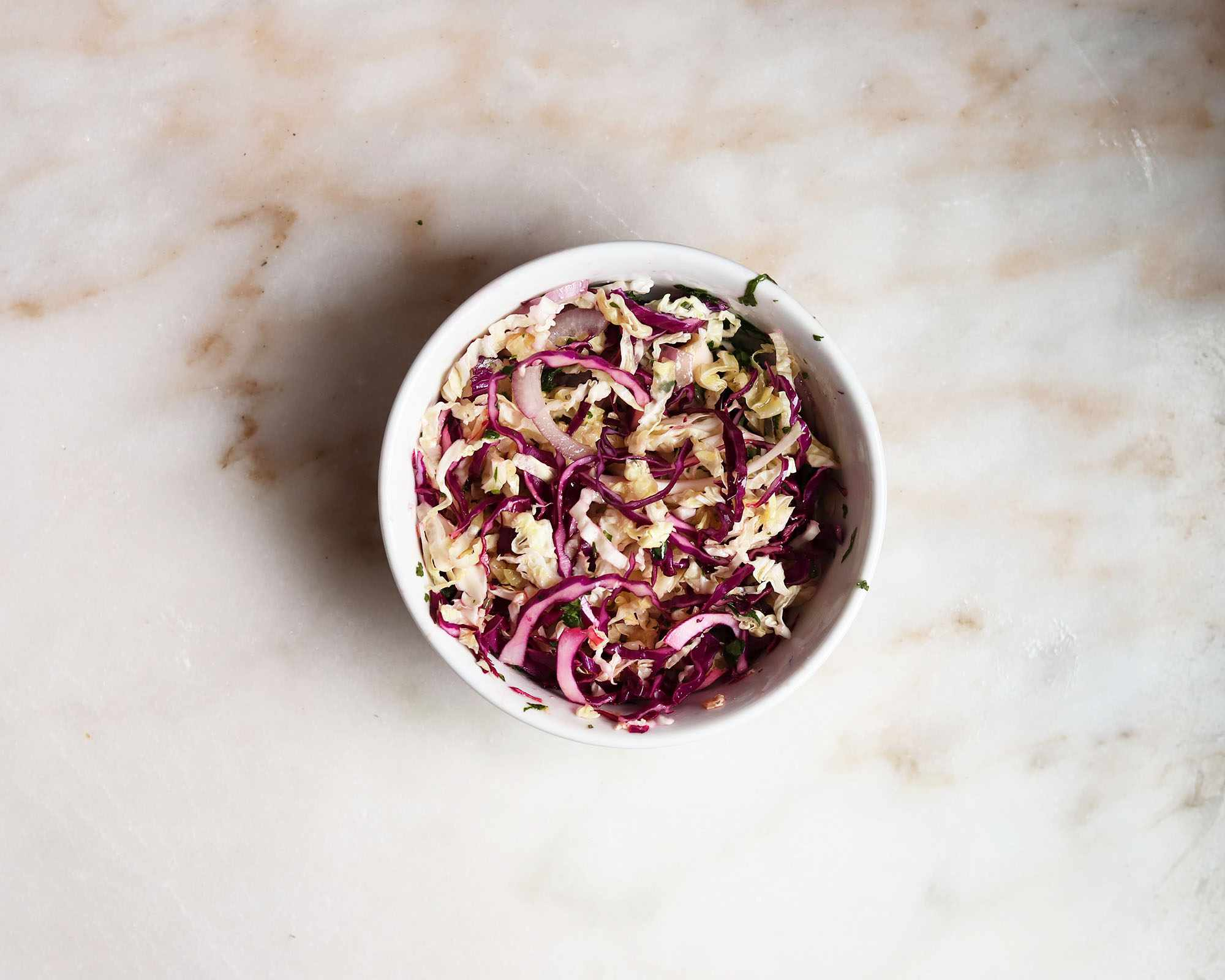 cabbage slaw mixed in a bowl