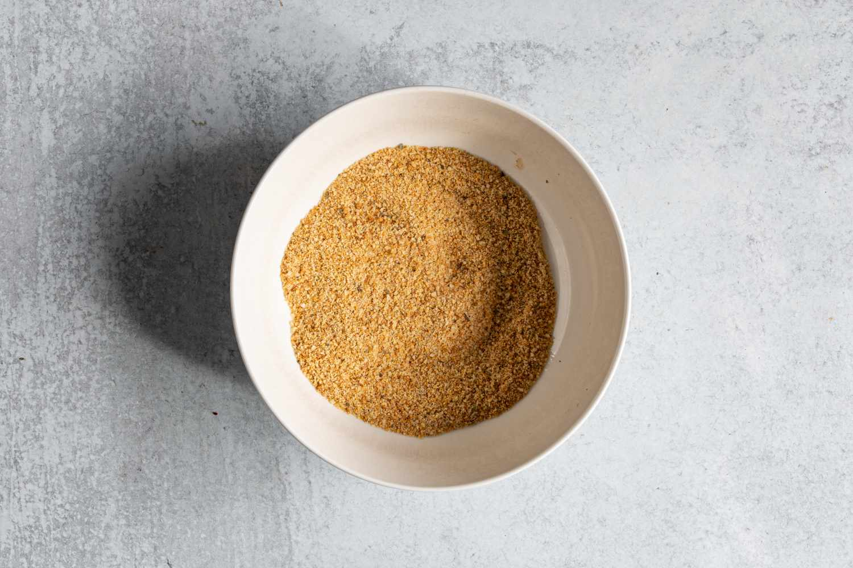 breadcrumbs, Italian seasoning, garlic powder, onion powder, and seasoned salt in a bowl