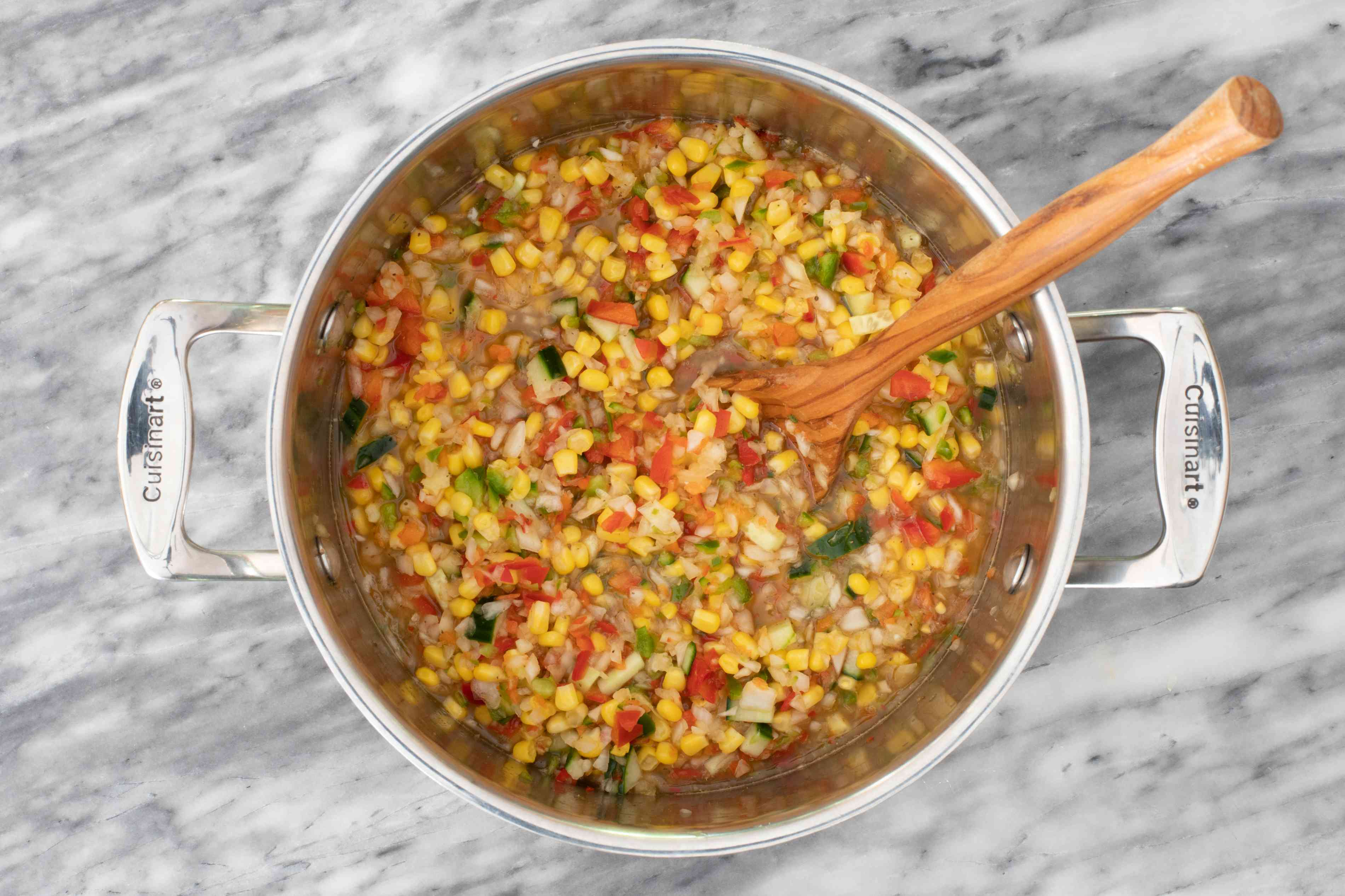 Combine the corn and other ingredients in a stockpot.