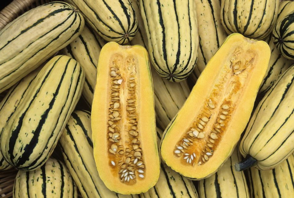 Delicata squash cut in half and whole