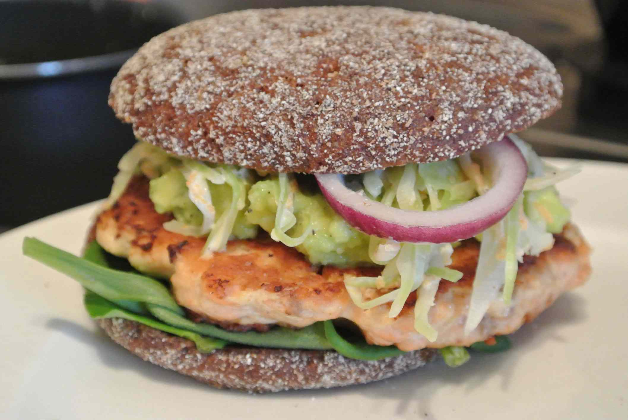 Salmon burger with coleslaw and avocado