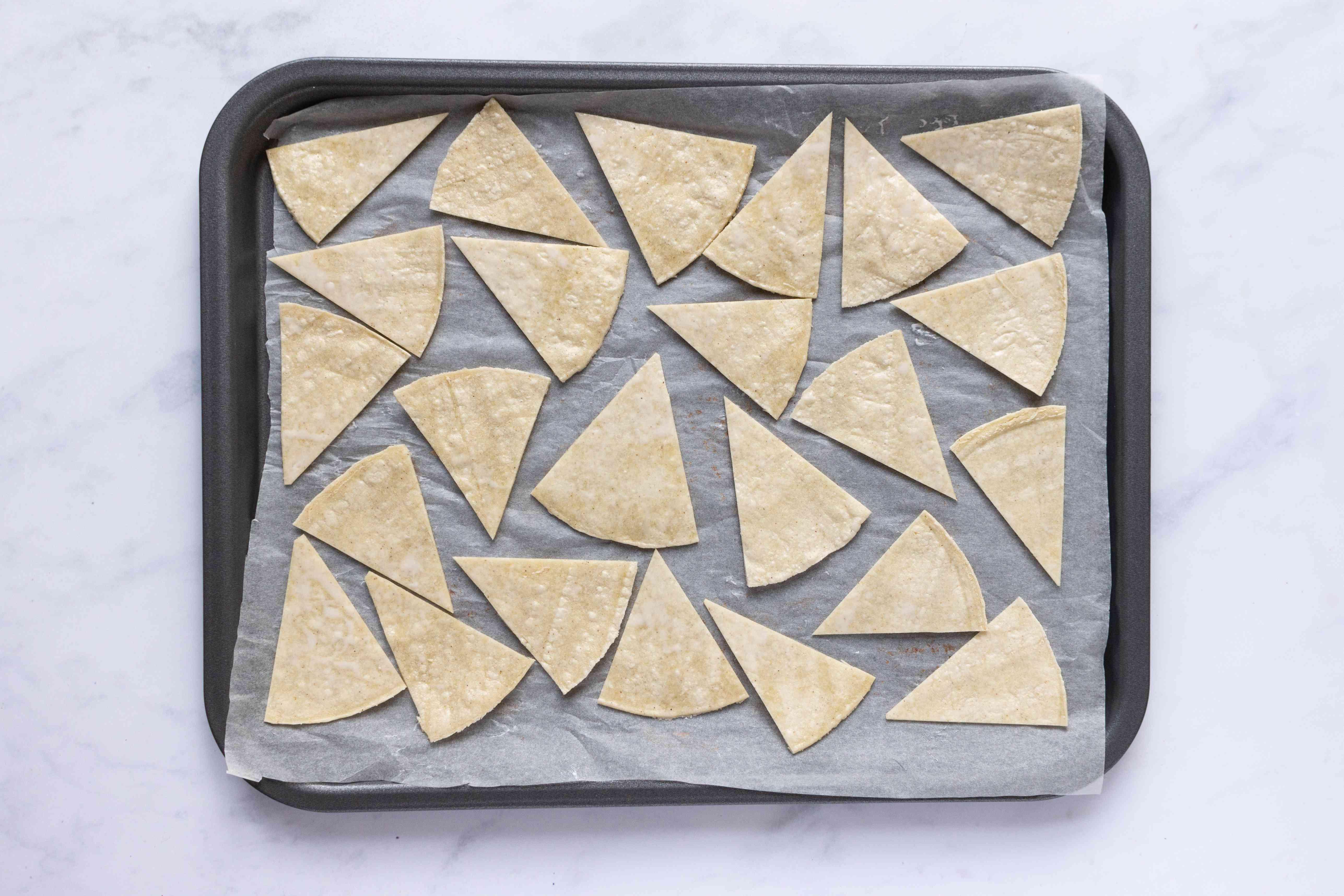 tortilla pieces on a baking sheet