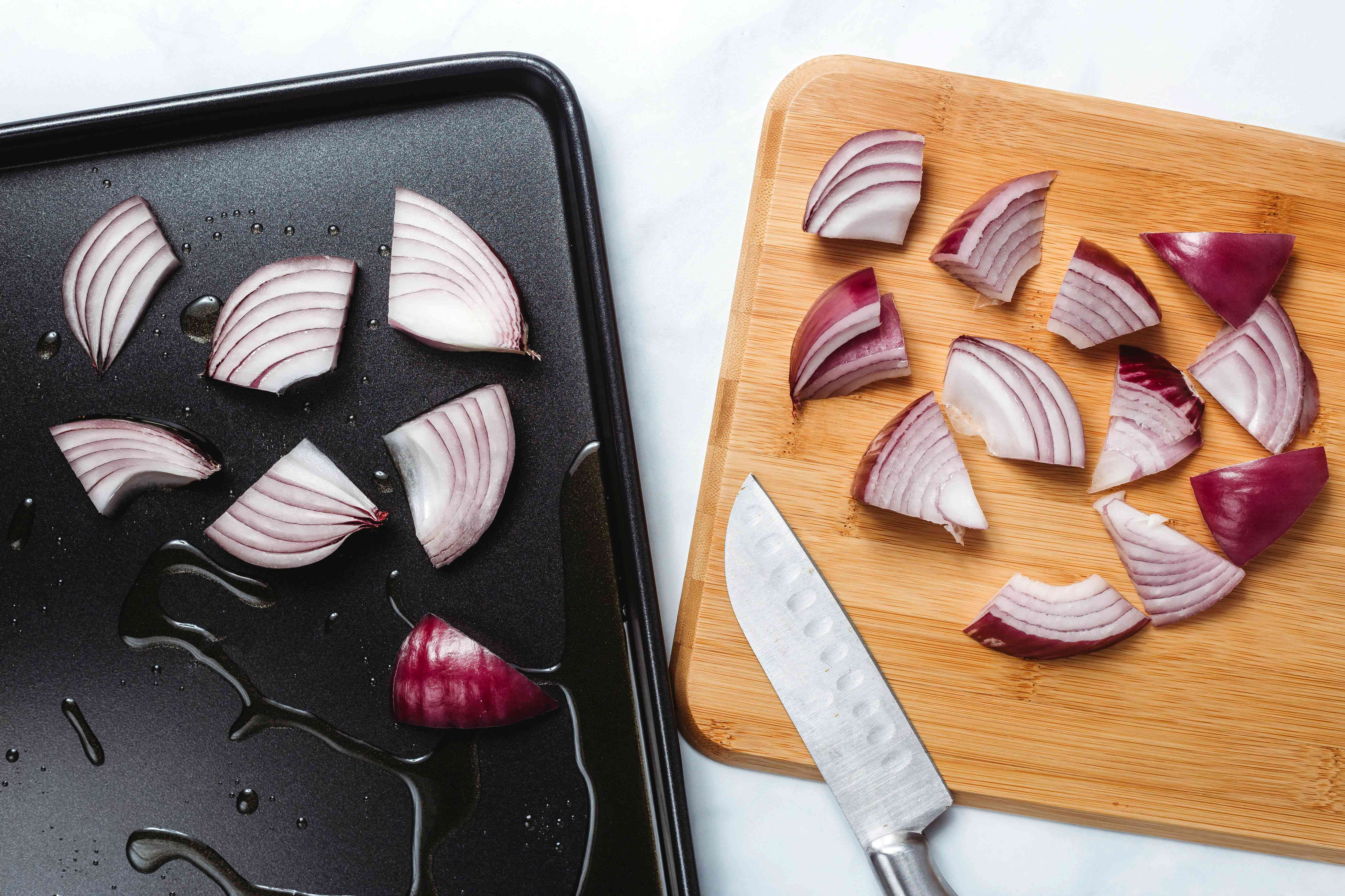 red onion pieces on a baking sheet