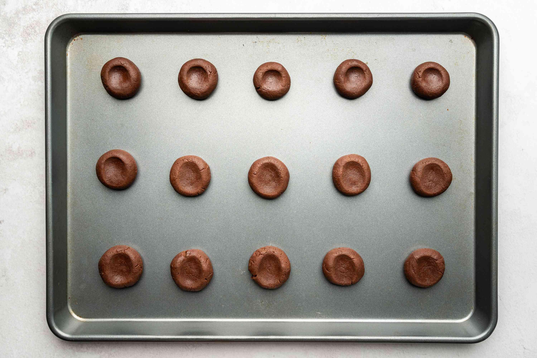 dough balls on a baking sheet