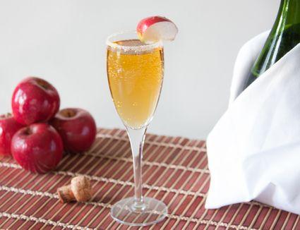 Apple Cider Mimosa With Apple Garnish and Cinnamon Sugar Rim
