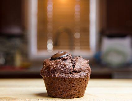 Chocolate muffin on countertop