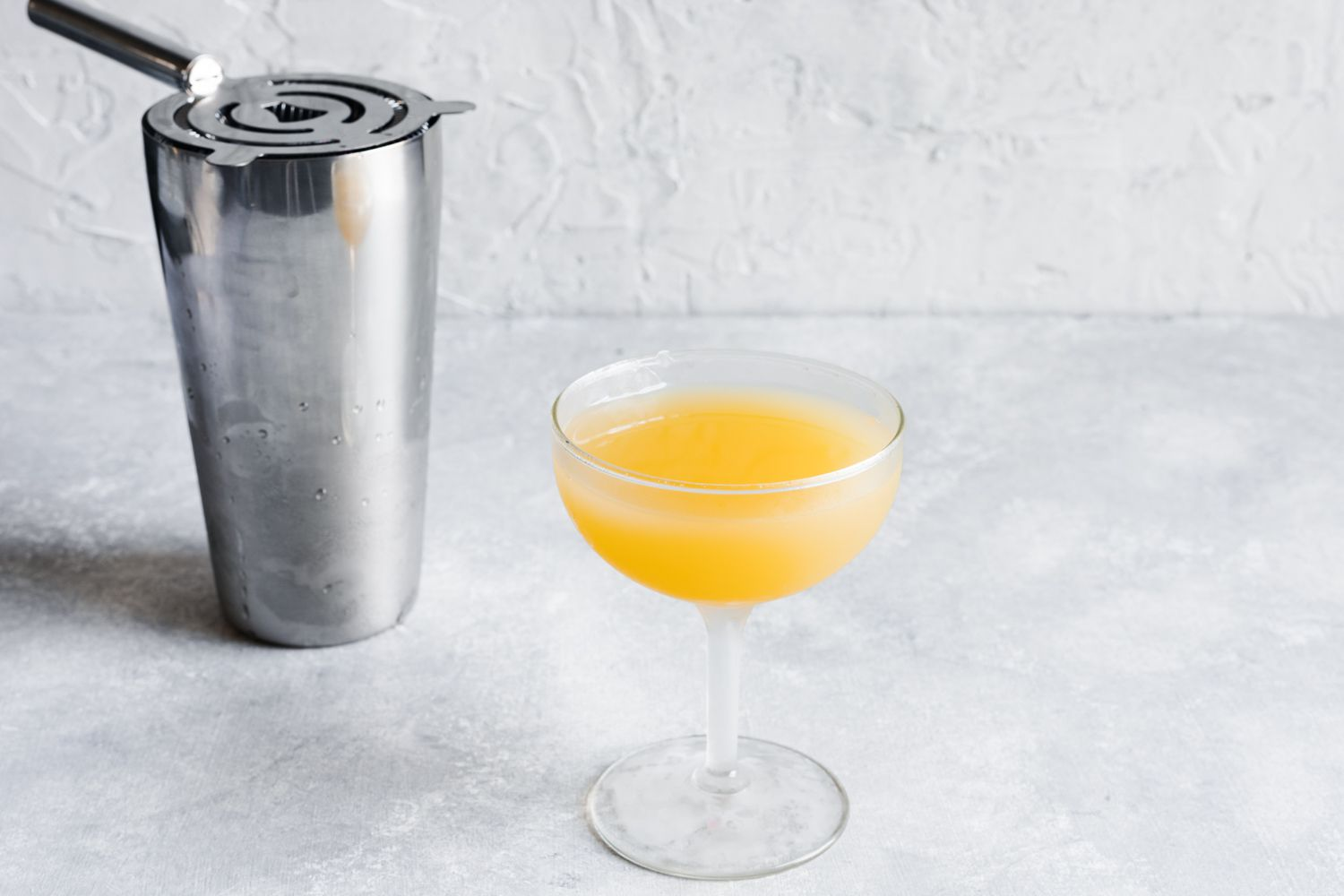 Strain cocktail into a chilled cocktail glass