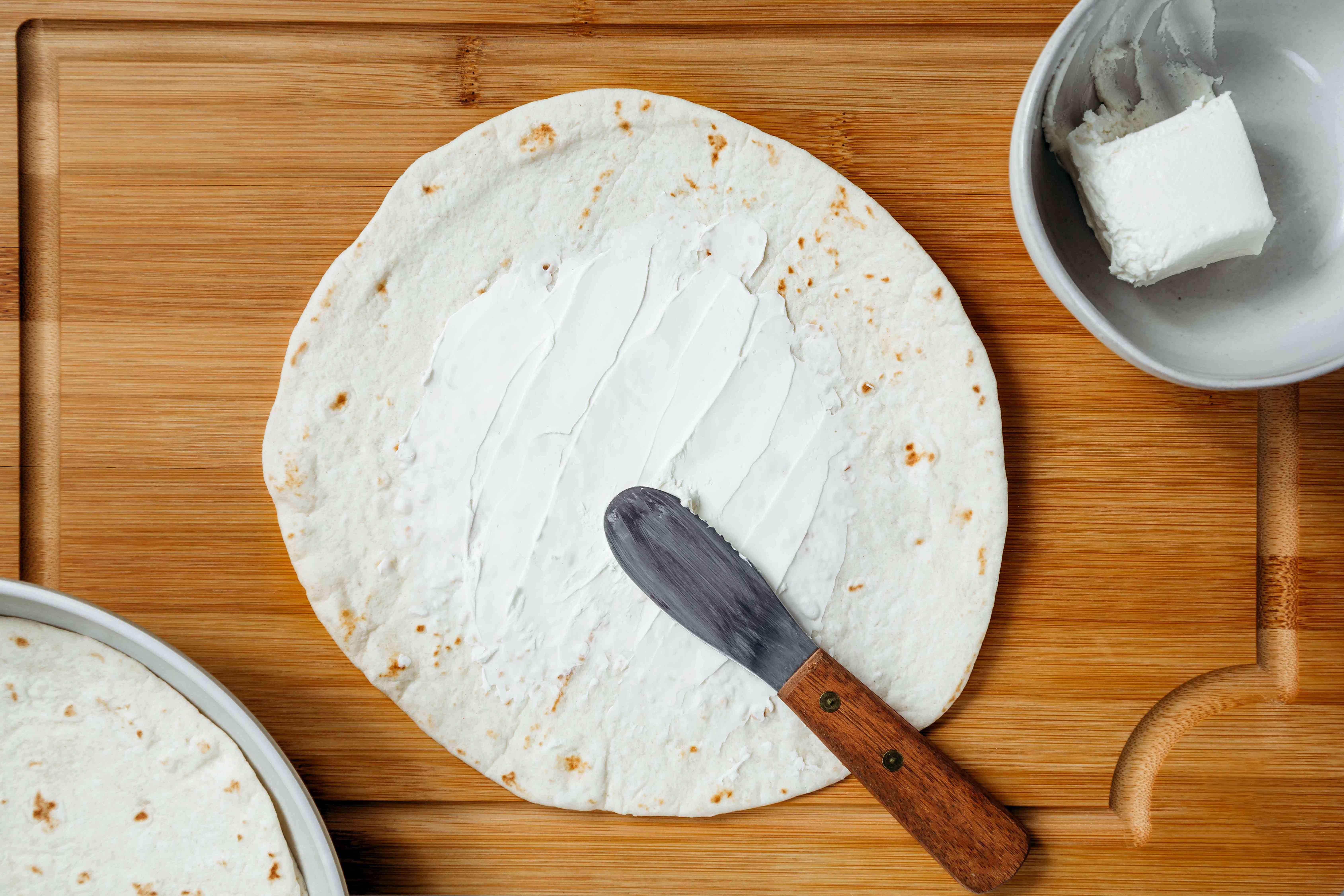 Cream cheese spread on a flour tortilla