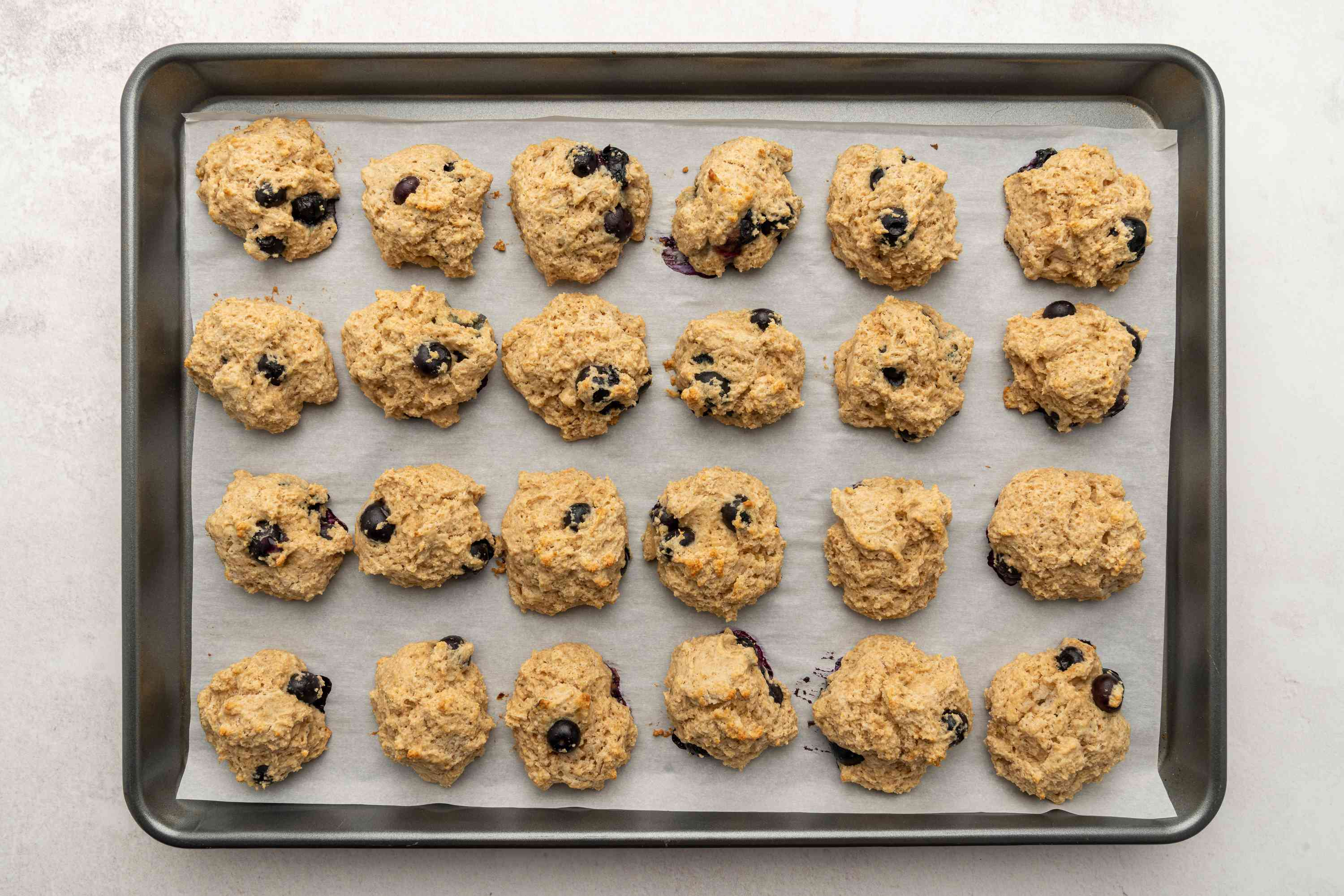 Low-Fat, Low-Calorie Blueberry Scones on a baking sheet