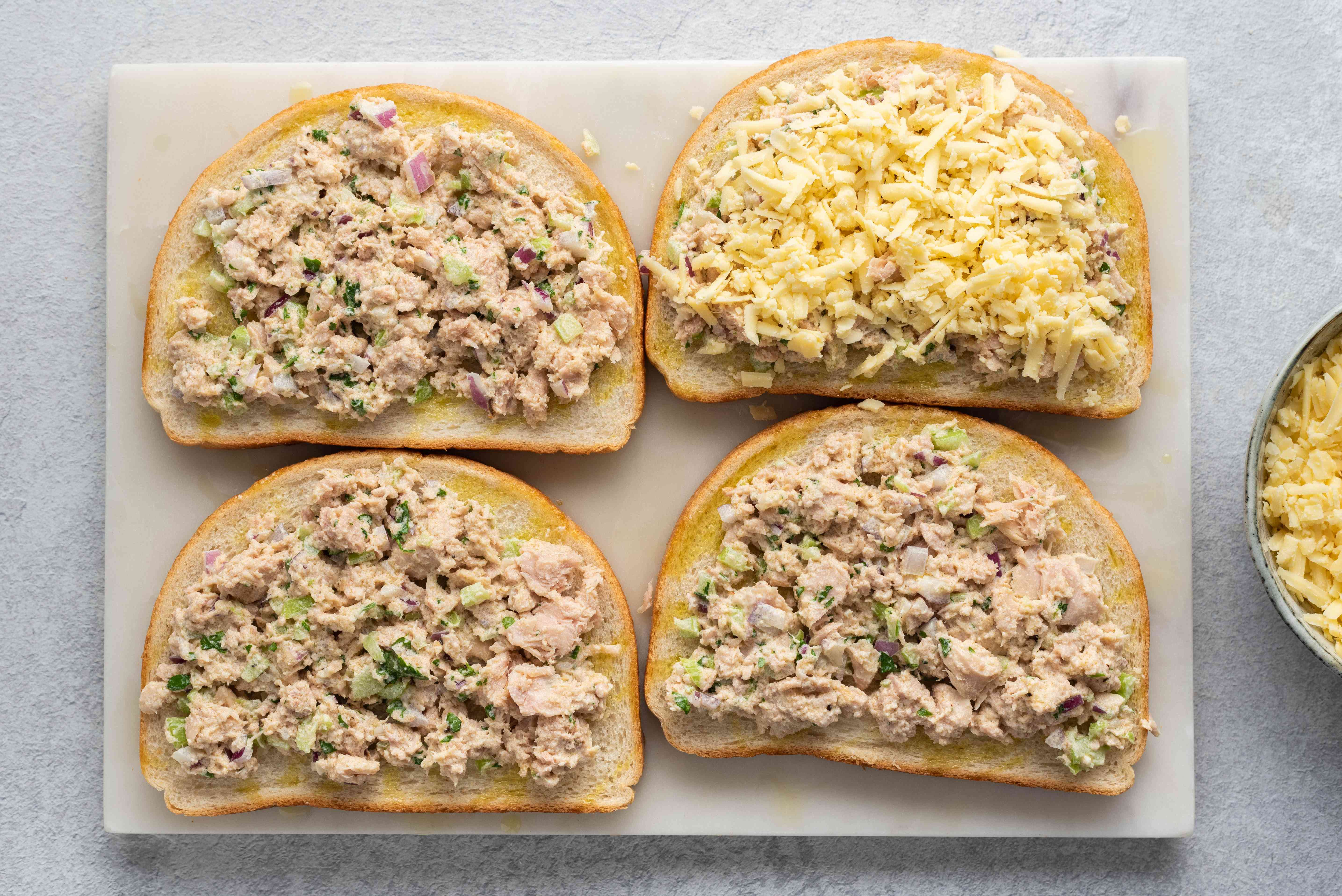 bread slices with a tuna mixture and cheese