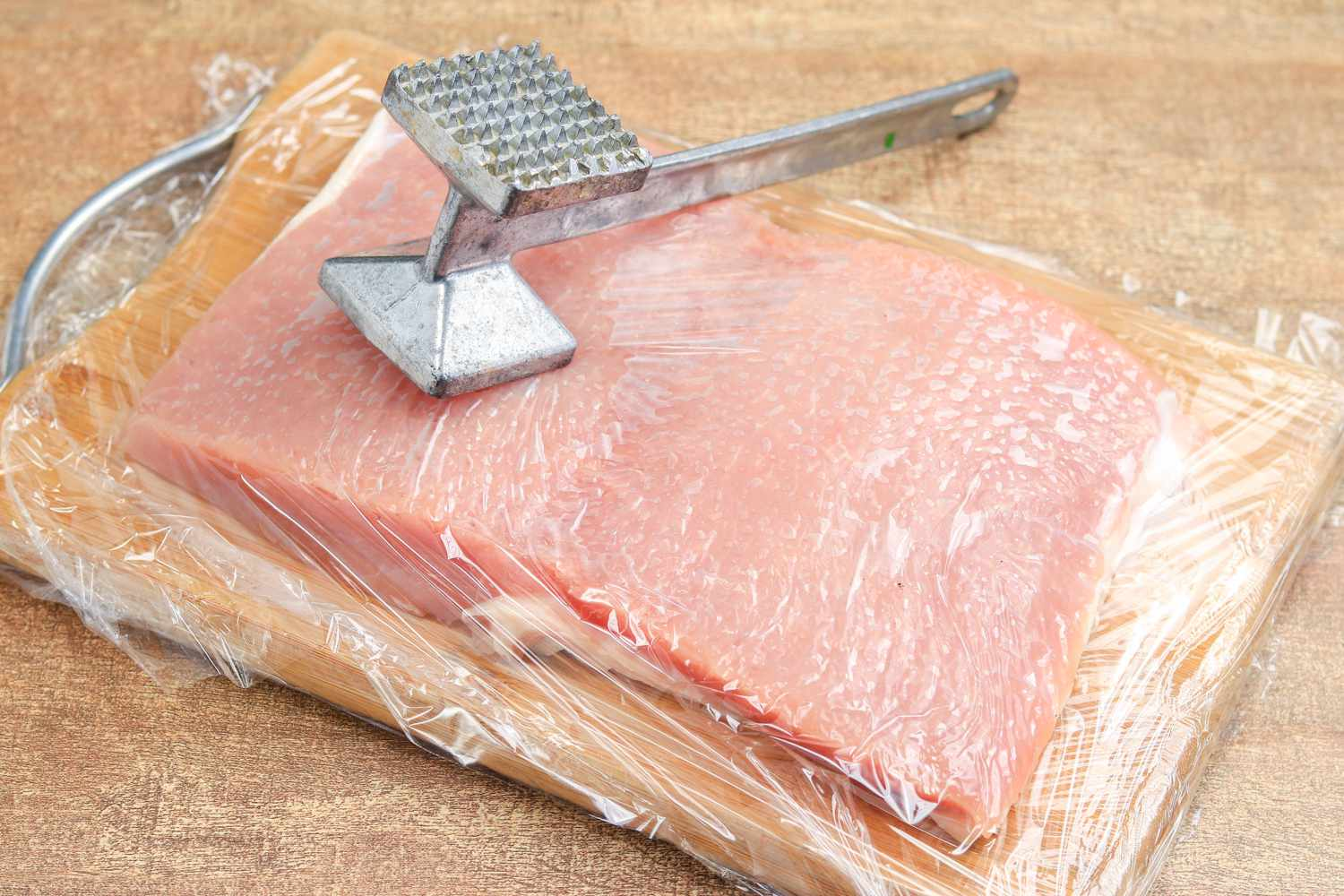 pork loin meat butterflied and flattened with hammer