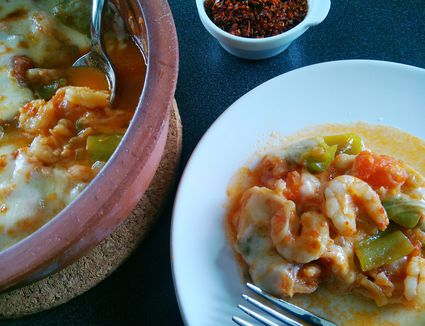 Shrimp and vegetable casserole is a cheesy, delicious Turkish hot 'meze,' or starter, usually served with fish and seafood menus.
