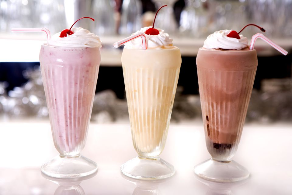 A vanilla, strawberry, and chocolate frappe milkshake