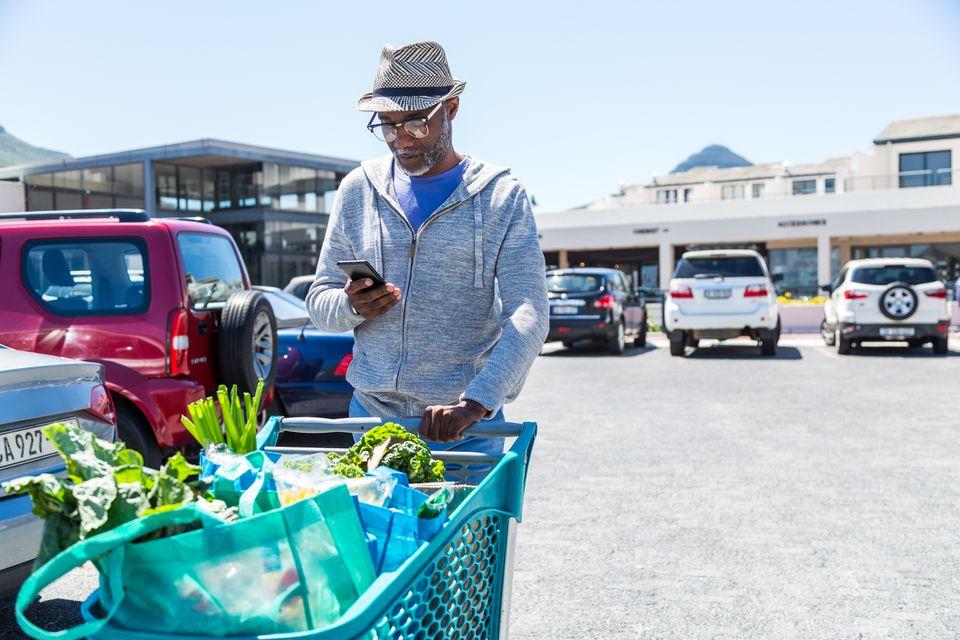 African American Man Pushing Grocery Cart