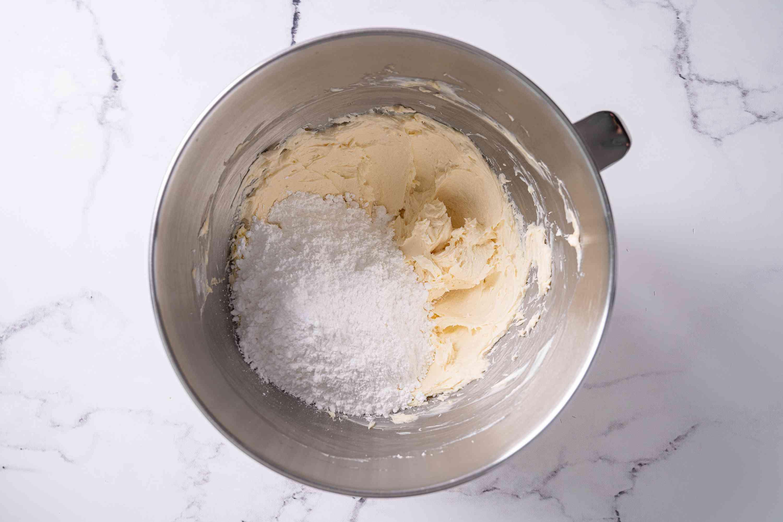 Gradually add the powdered sugar