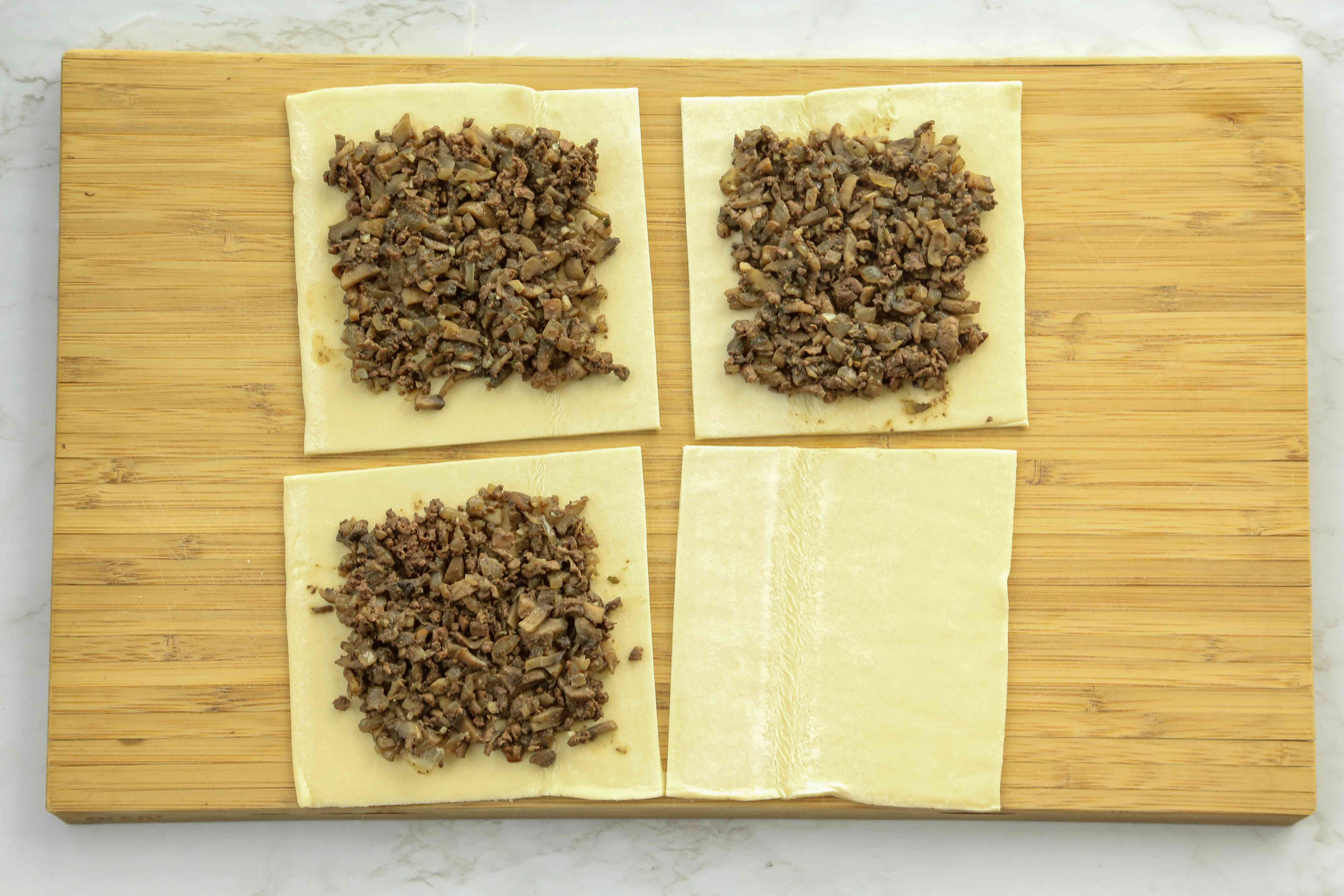 Place mushroom mixture on top of puff pastry