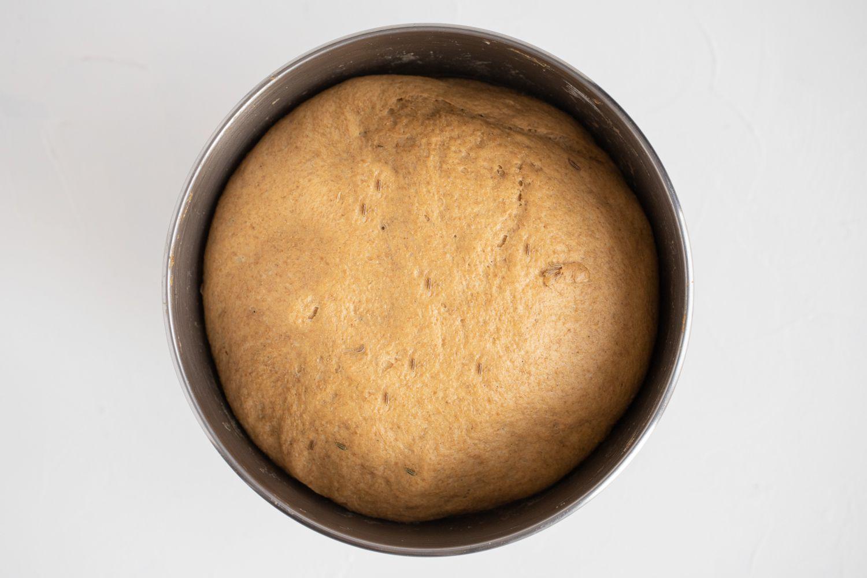 Pumpernickel Bread dough rising in a bowl