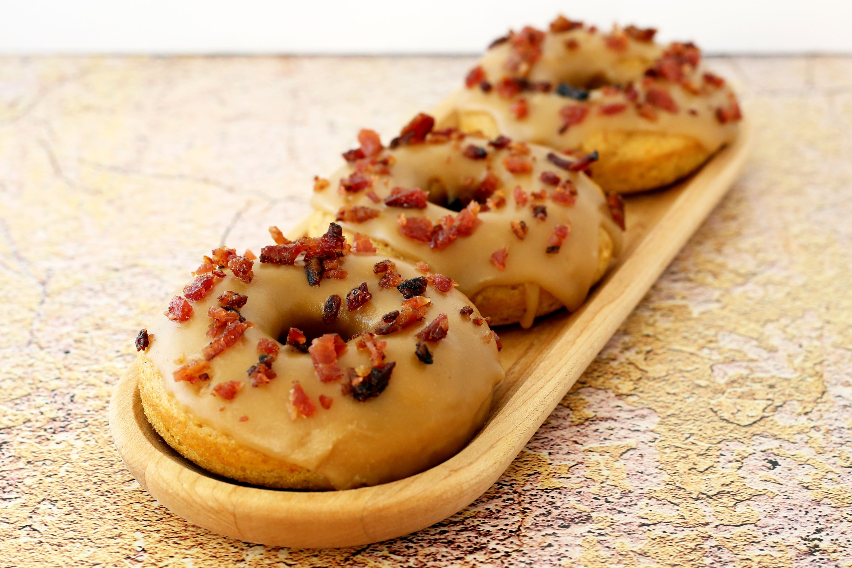 sweet potato doughnuts with maple glaze and candied bacon