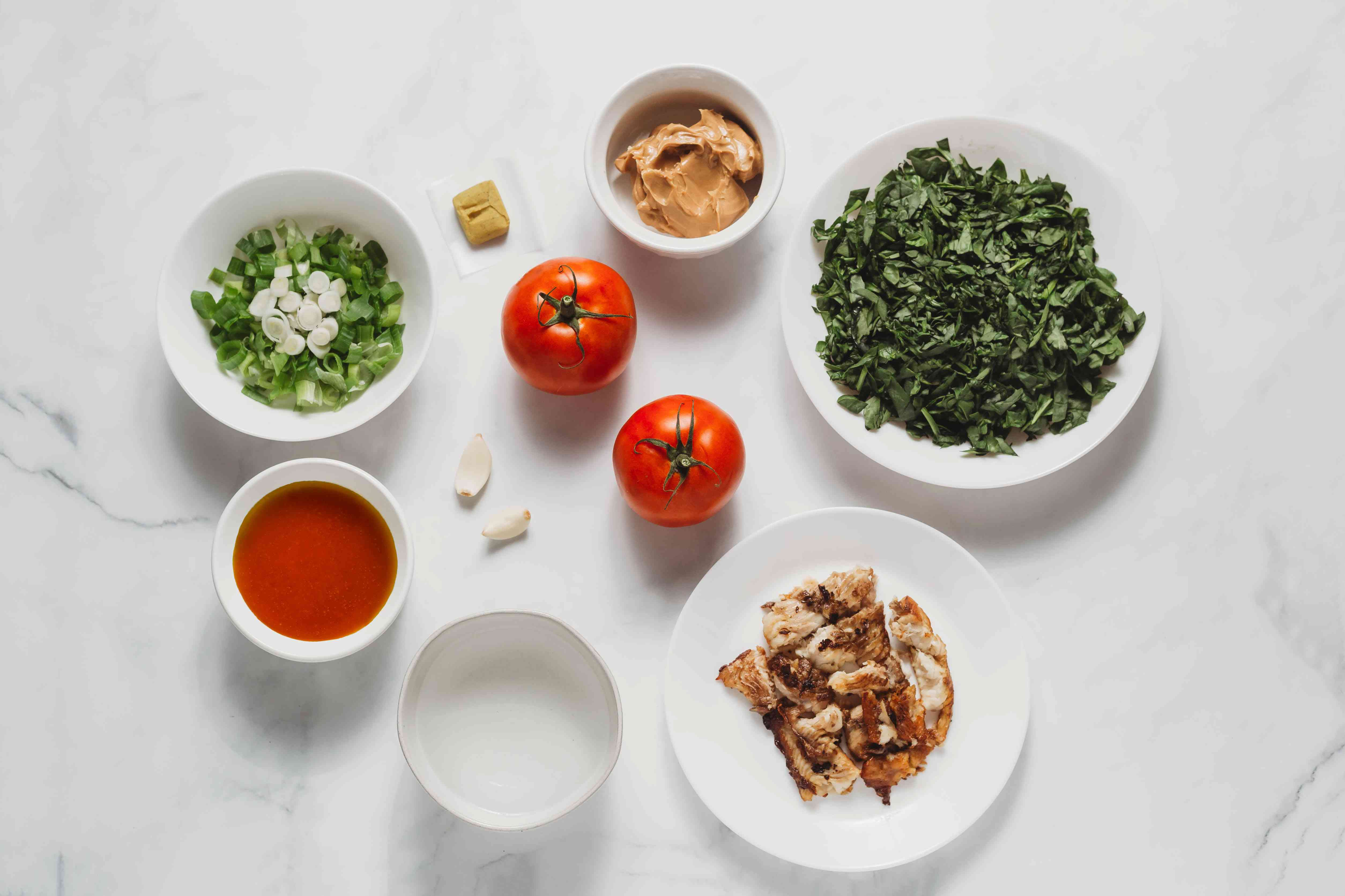 Fumbwa Recipe (Congolese Wild Spinach Stew) ingredients spinach, water, onion, garlic, tomatoes, stock cube, smoked fish, palm oil, ground peanuts