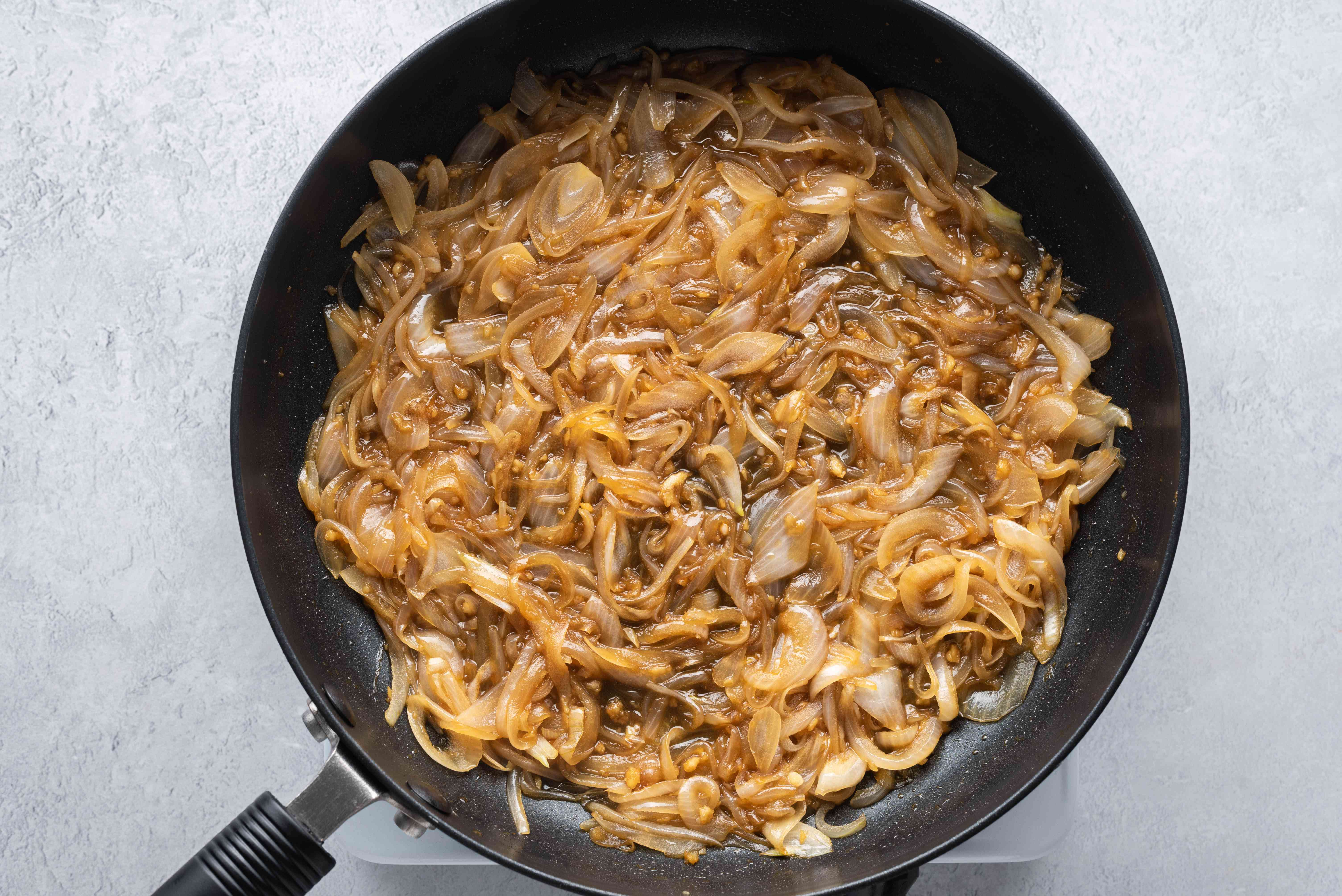 Stir the brown sugar and vinegar into the onions