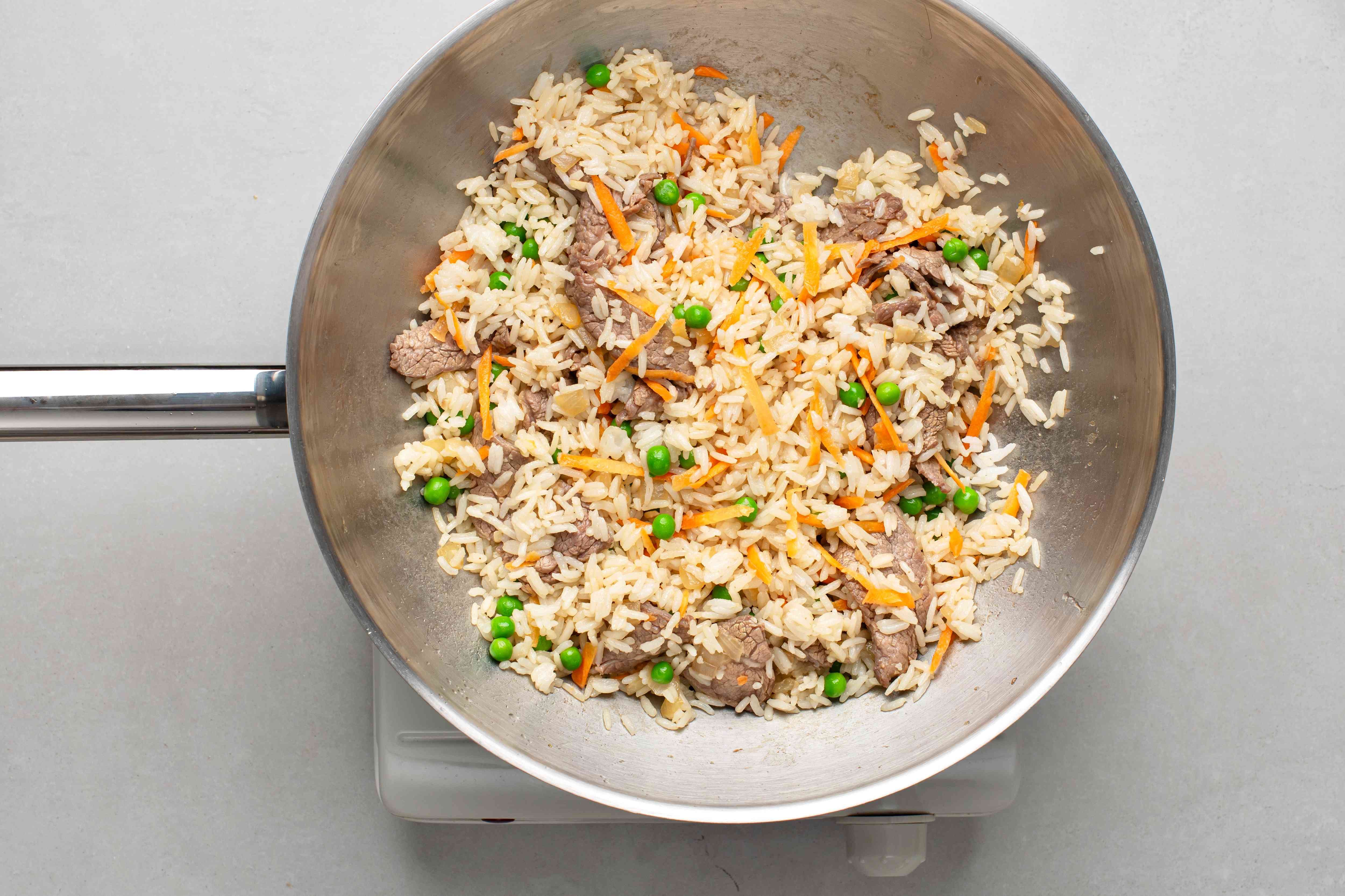 add carrots and peas to the beef and rice mixture