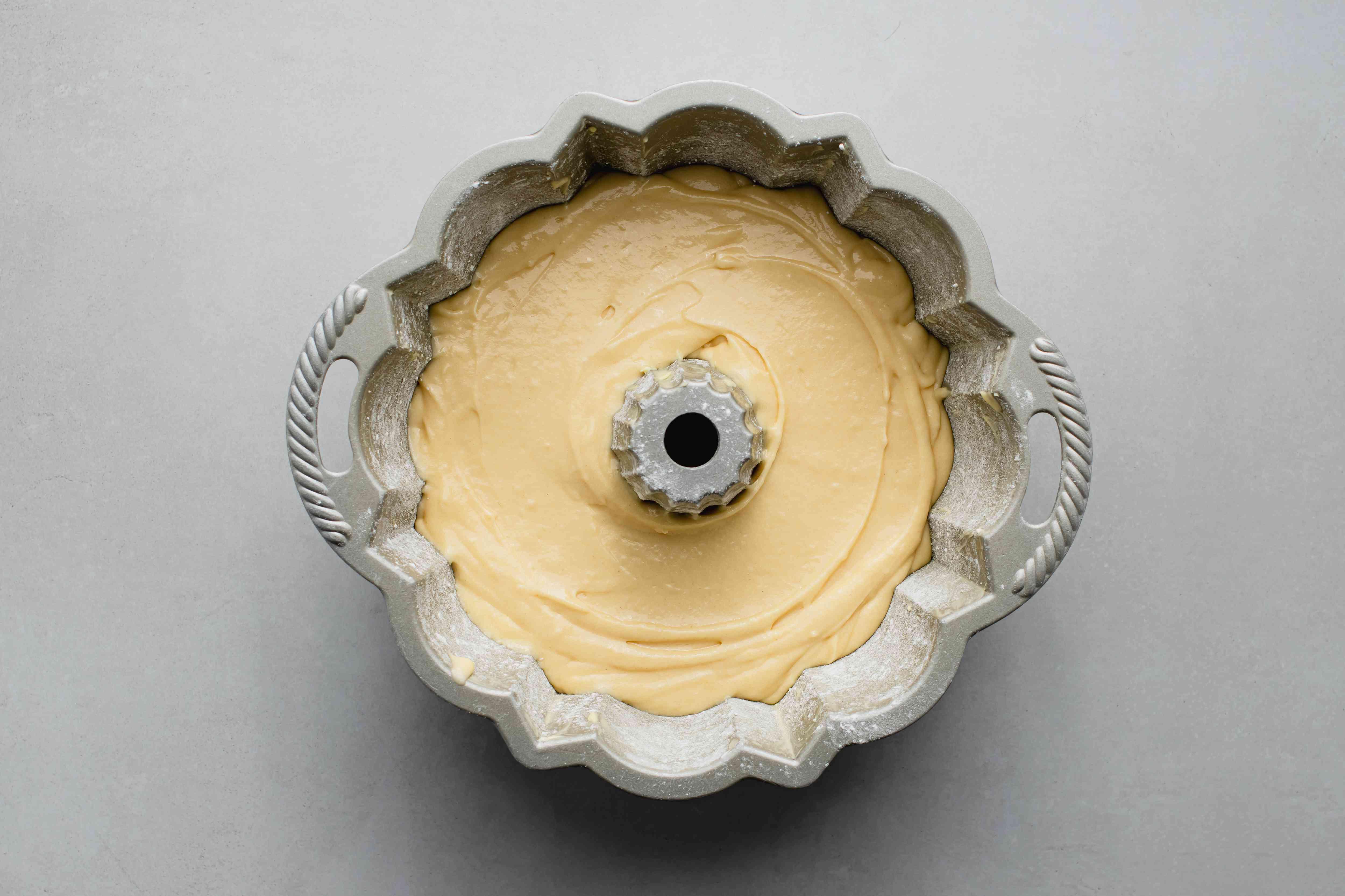 cake batter in the bundt cake pan