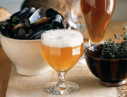 Two Glasses of Lambic Beer With a Bowl of Steamed Mussels and Thyme