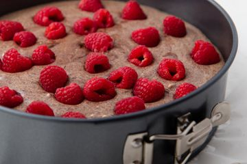 Chocolate Cheesecake With Raspberries in Spring Form Pan Ready to Go in the Oven