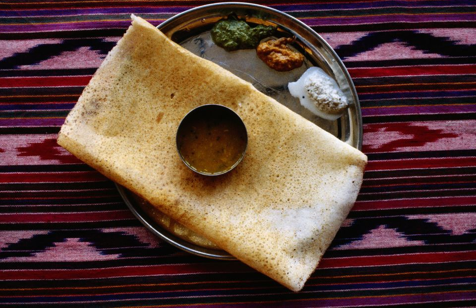Dosa on plate with sauces
