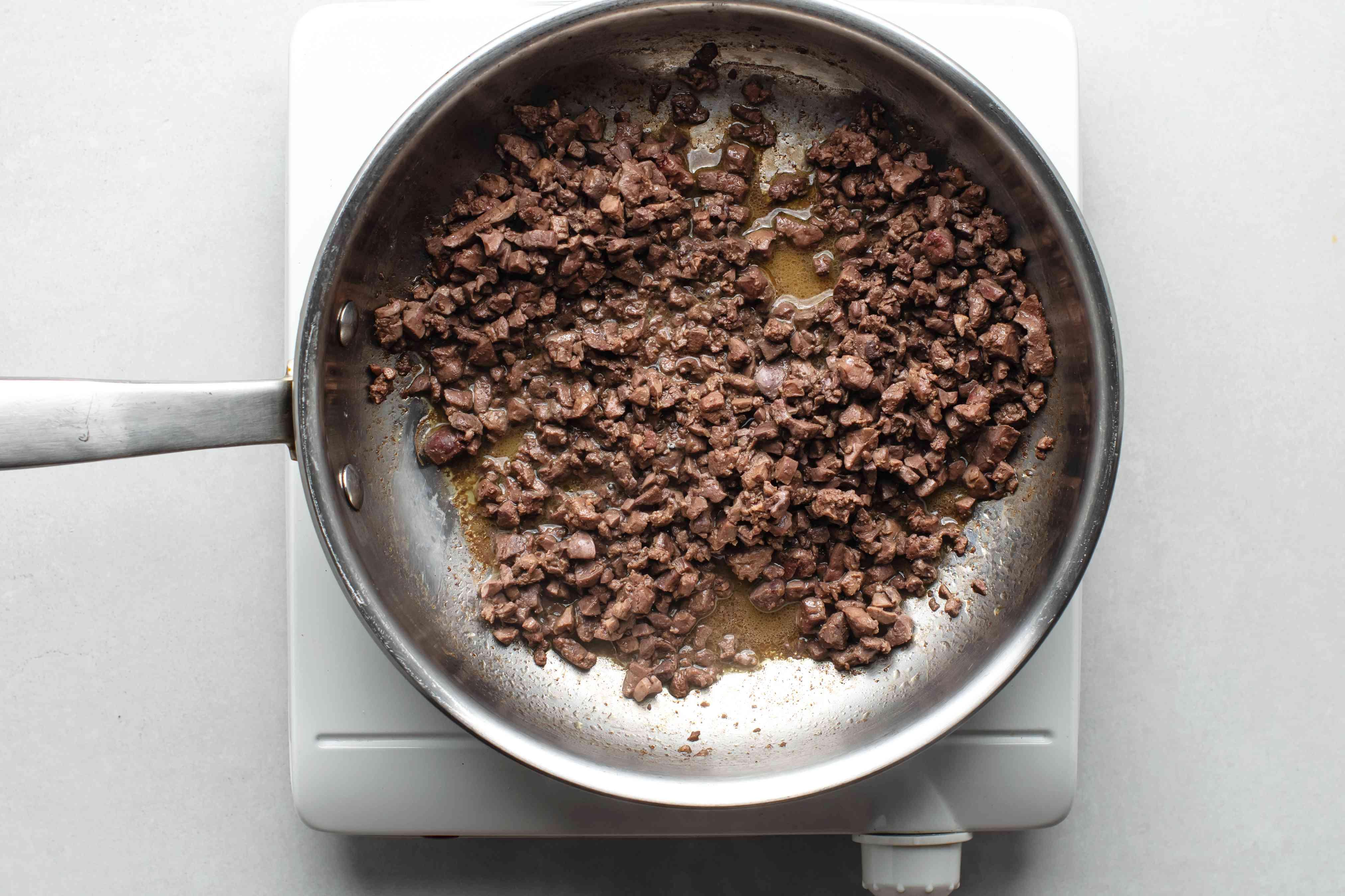 Sauté chicken livers in a pan
