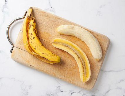 banana split open on cutting board