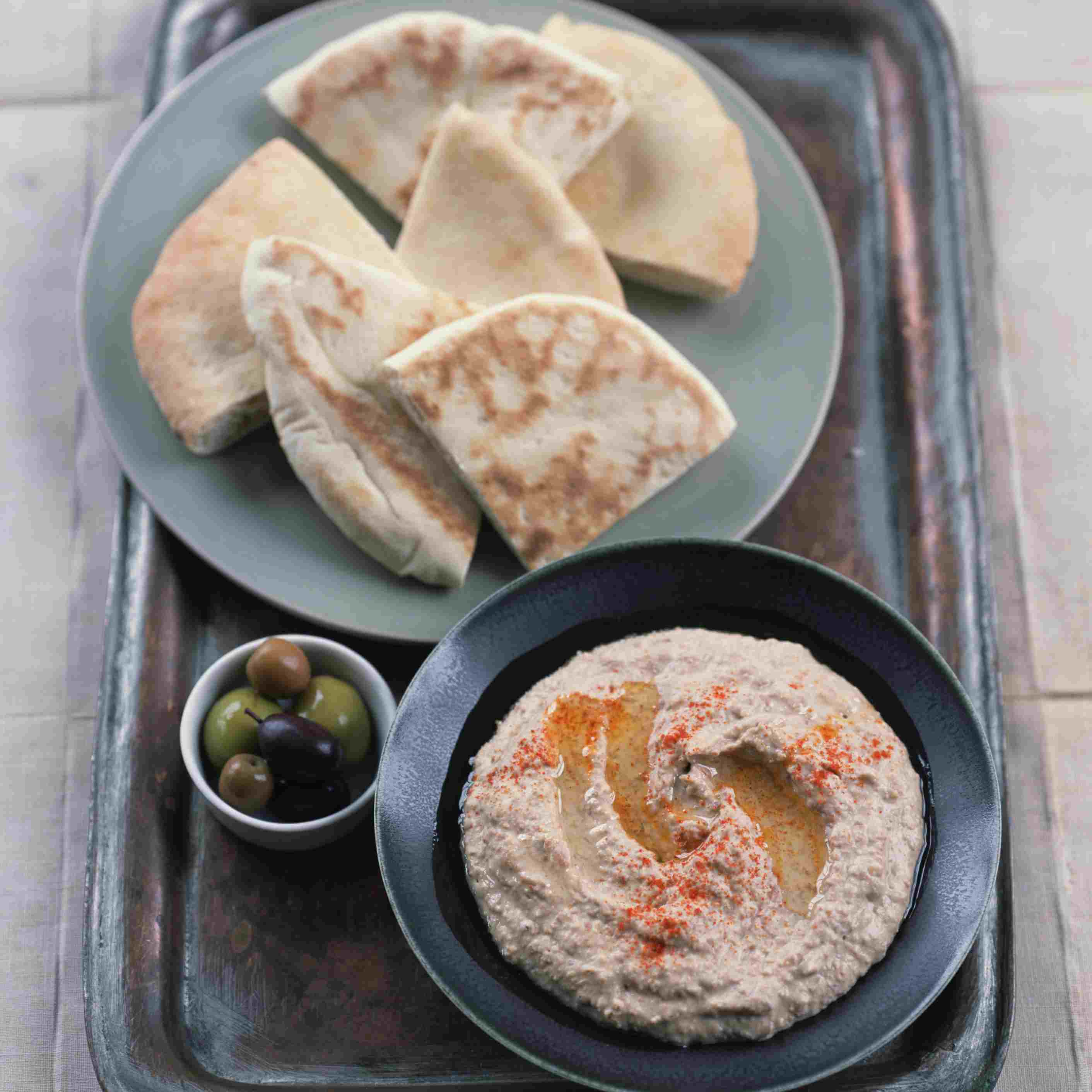 Hummus , olives and pita wedges