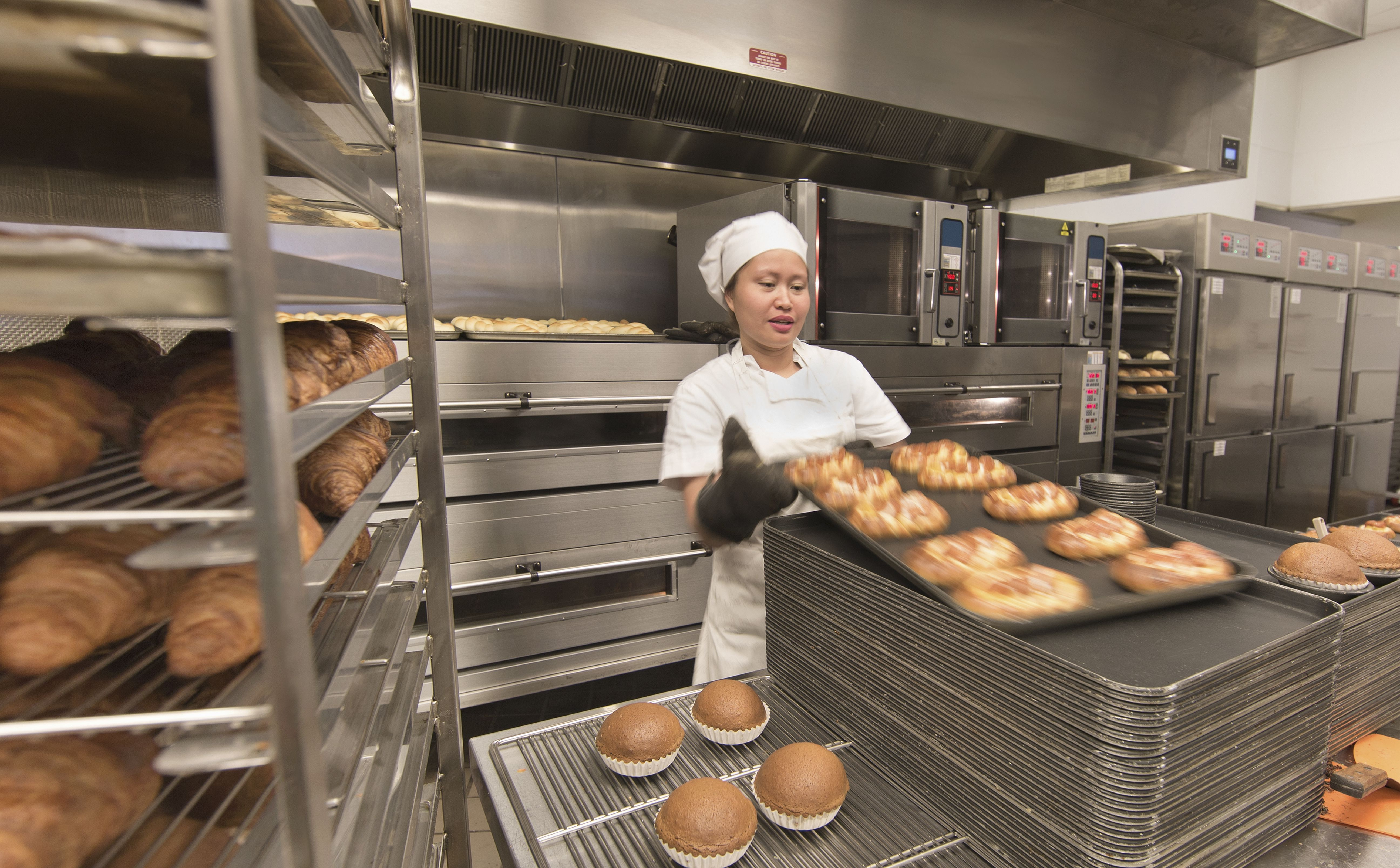 A woman baker working in a commercial kitchen