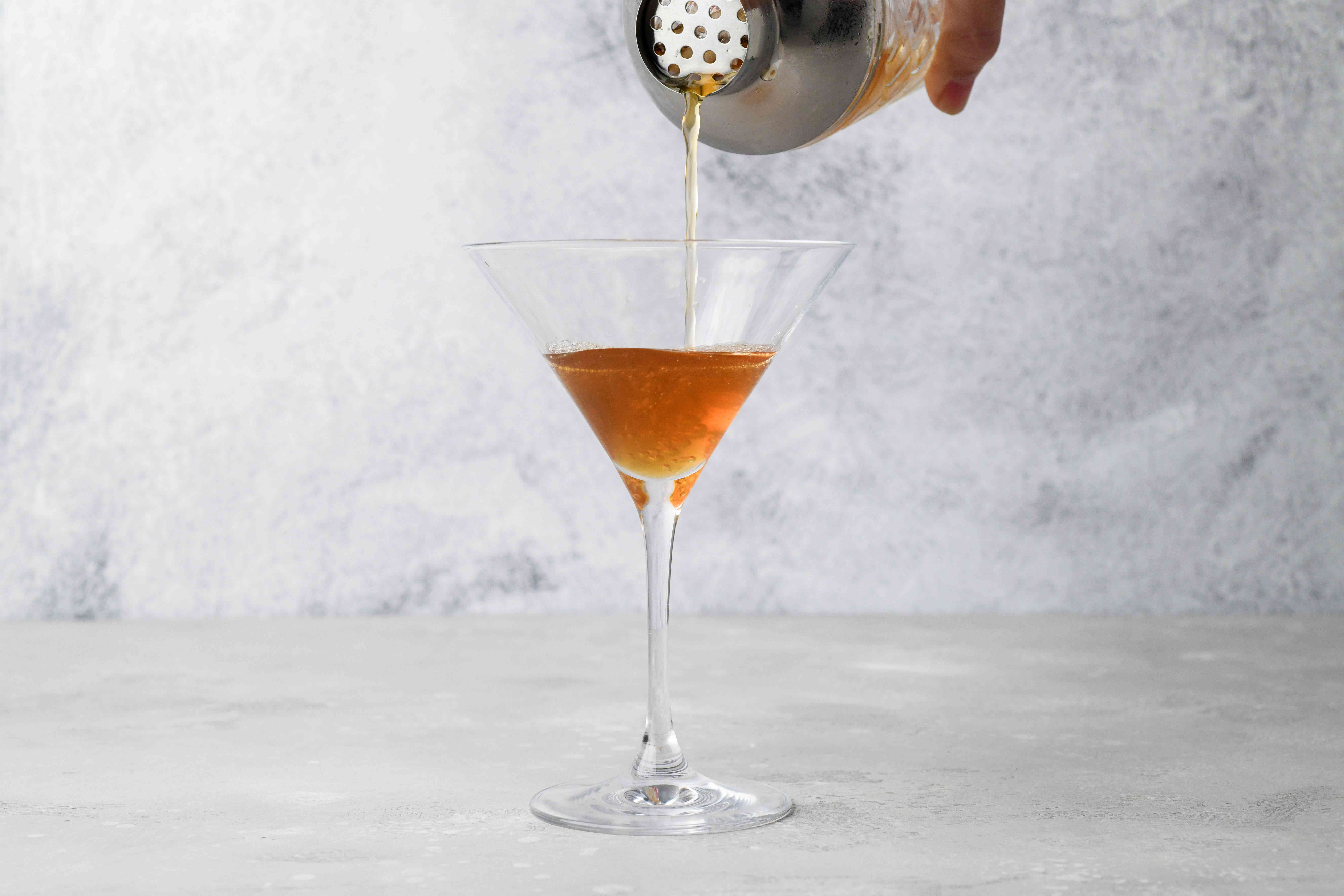 strain cocktail into a cocktail glass