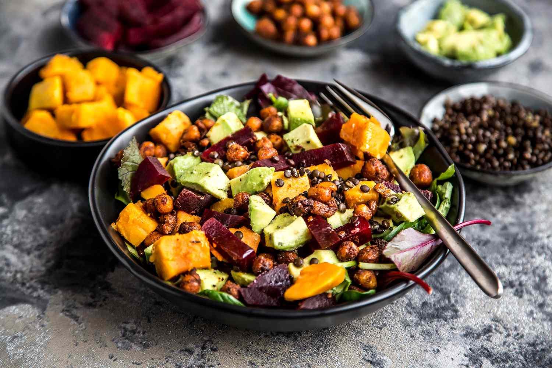 Superfood salad with avocado, beetroot, roasted chickpea, sweet potatoes, beluga lentils, and blood orange