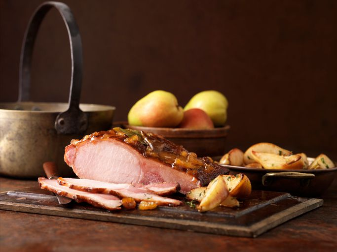 Christmas dinner. Roasted pear and muscavado sugar cured loin with potatoes, apples and herbs