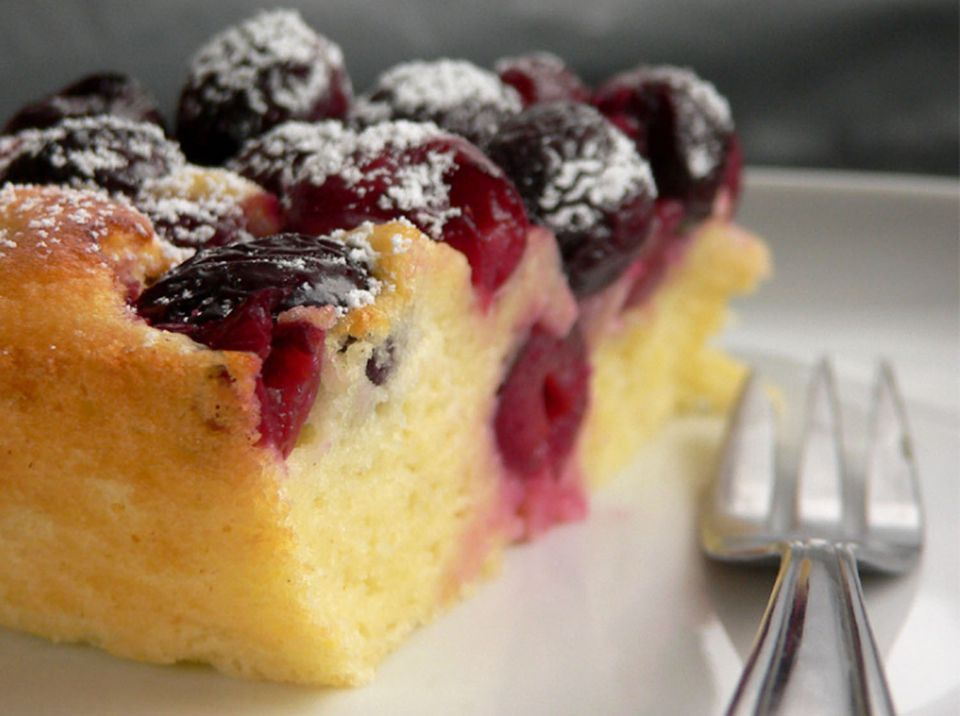 Close up of cherry custard cake with fork