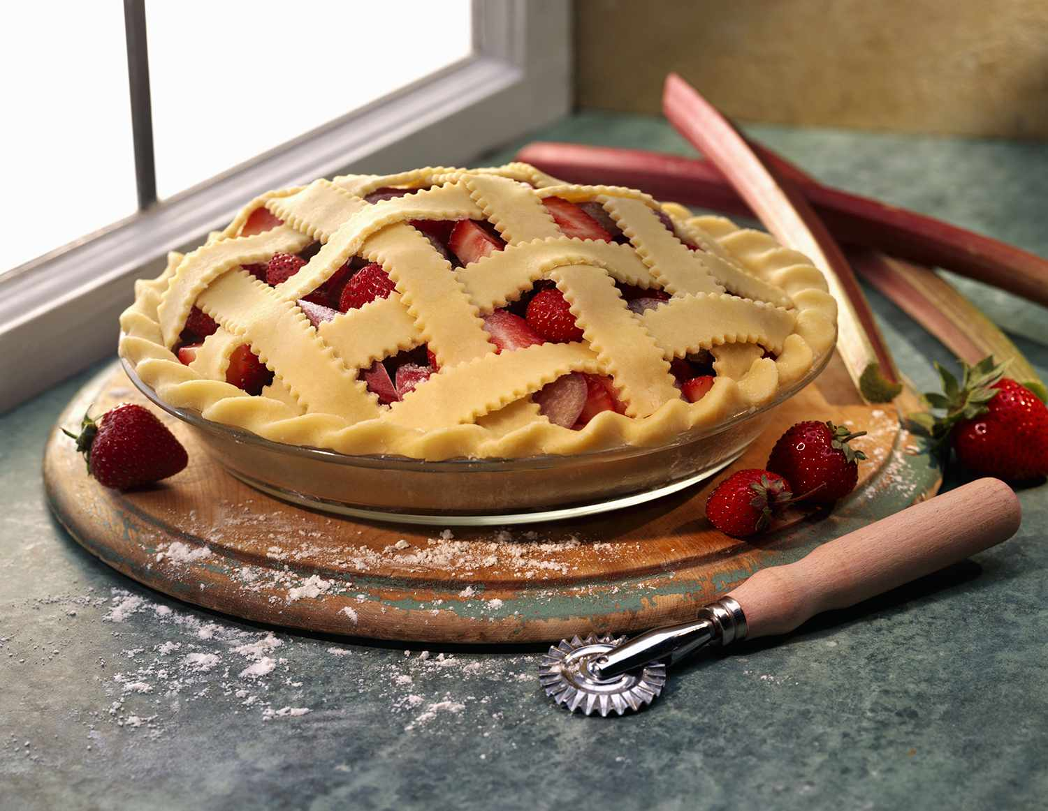 Strawberry rhubarb pie with a lattice crust, ready for the oven