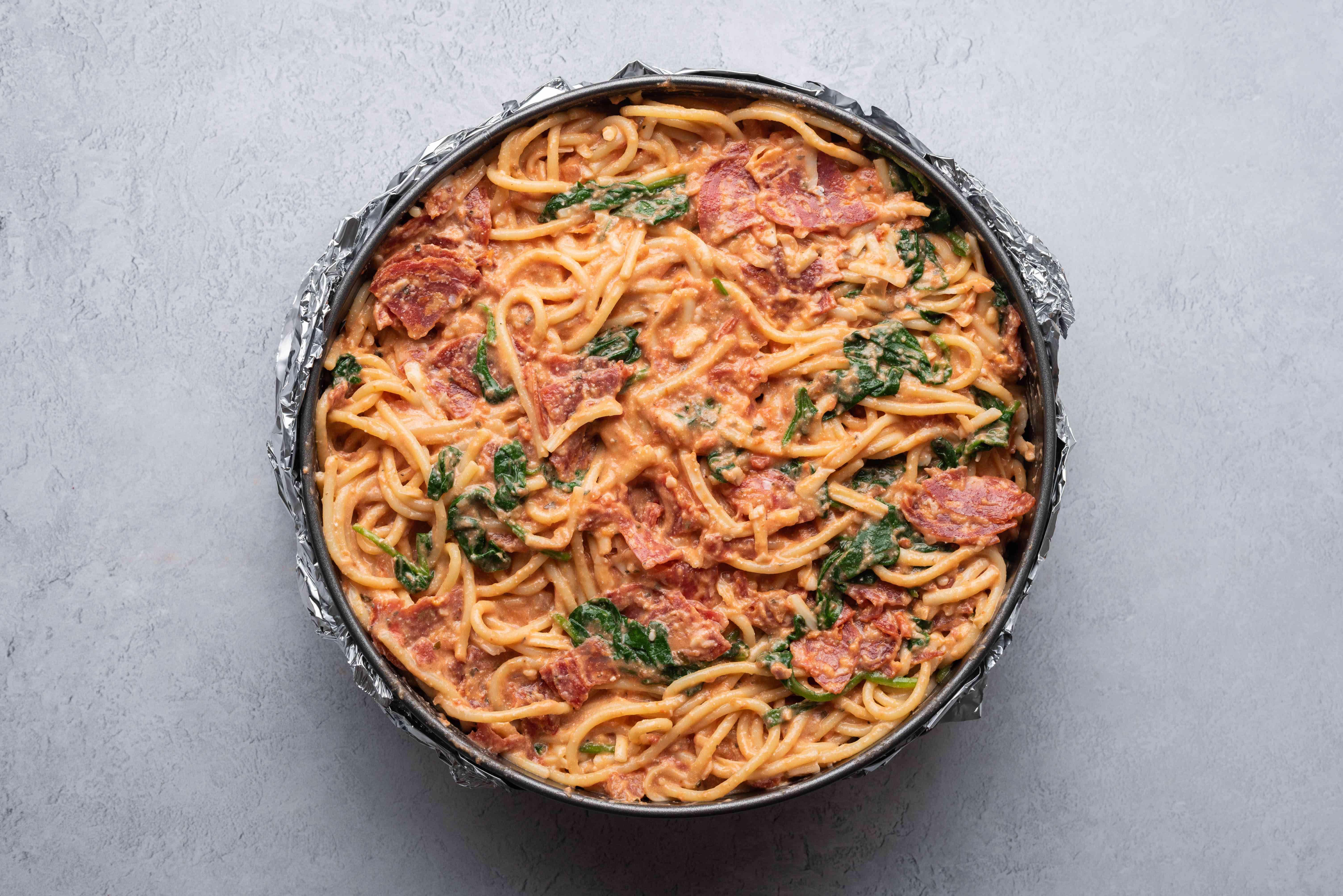 add pasta mixture to a springform pan