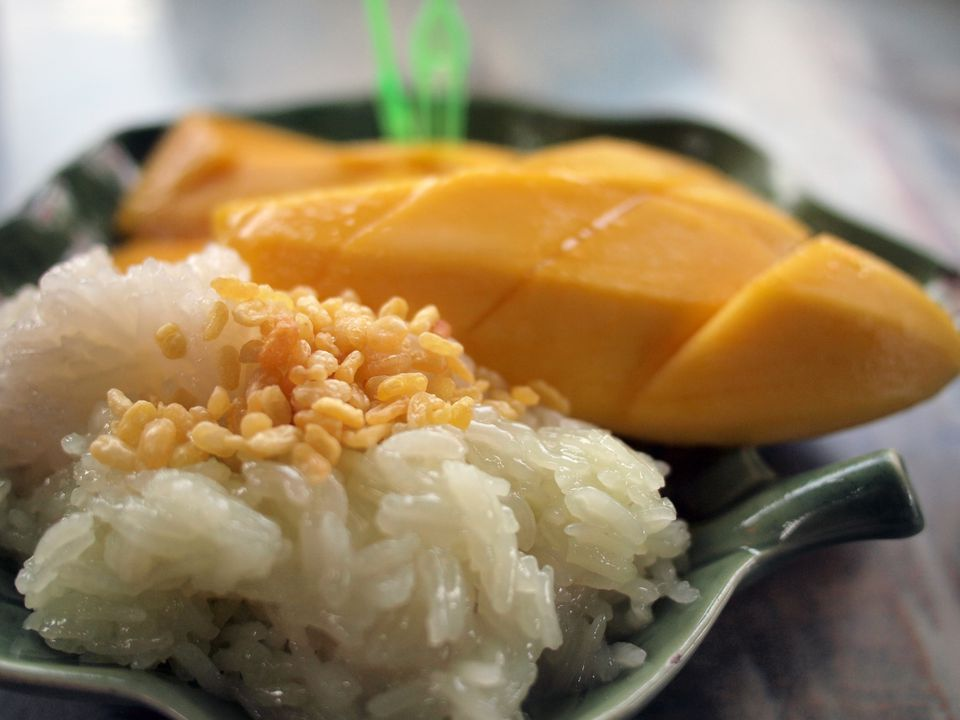 Sticky Rice with Peanuts and Mango on plate