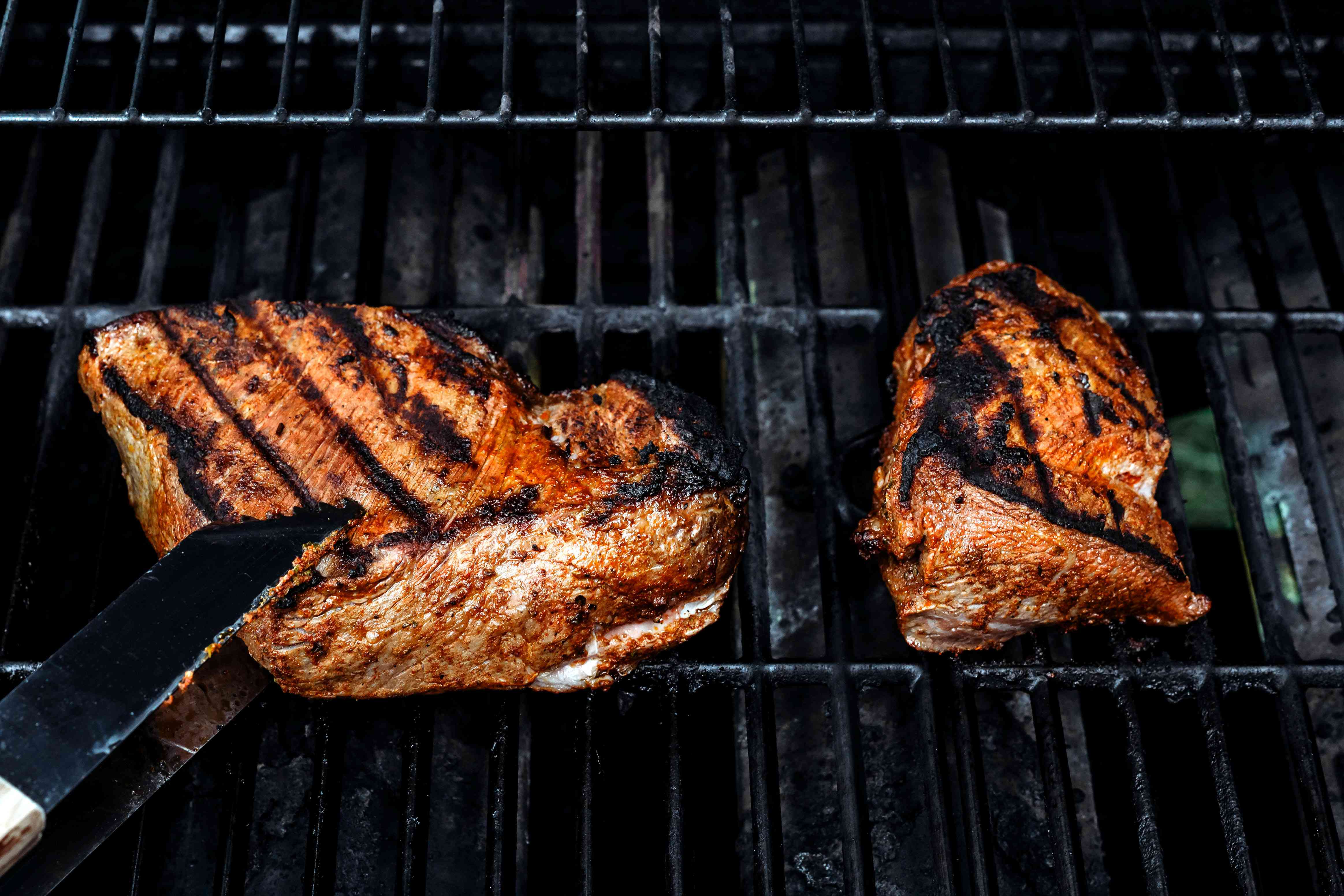 steak cooking on the grill