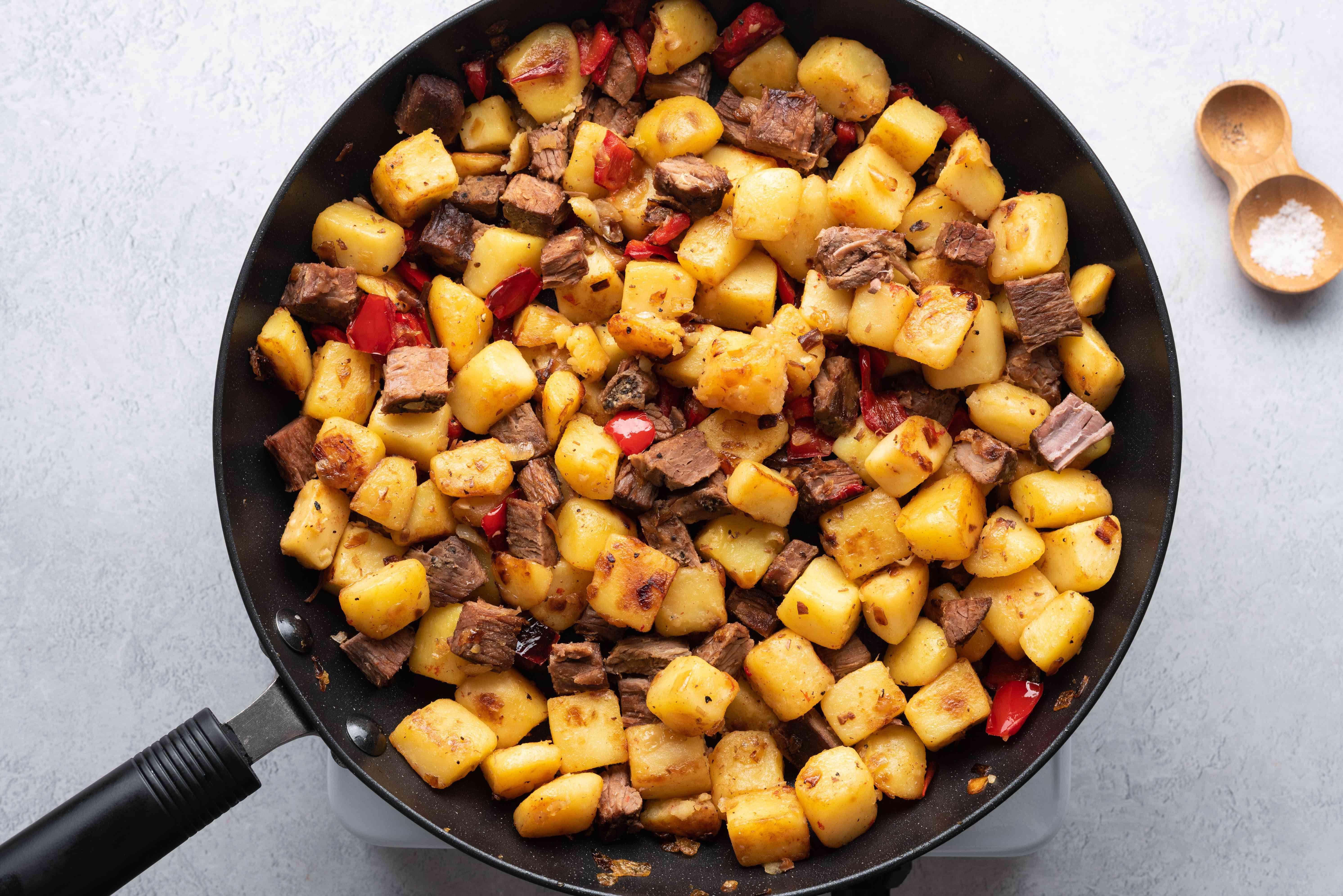 brisket hash cooking in the pan
