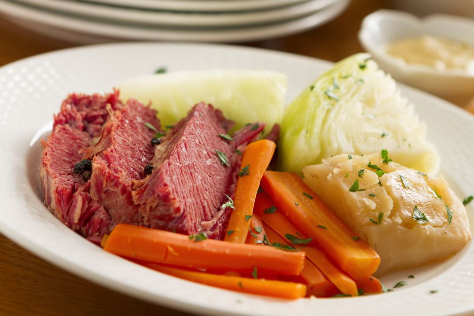 Corned Beef and Cabbage on plate with carrots.