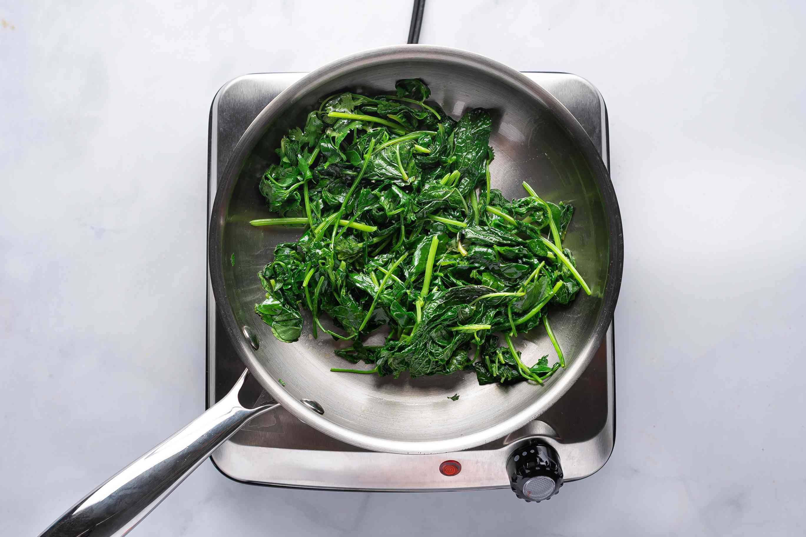 add the fresh coriander, fenugreek, and mint leaves to a pan