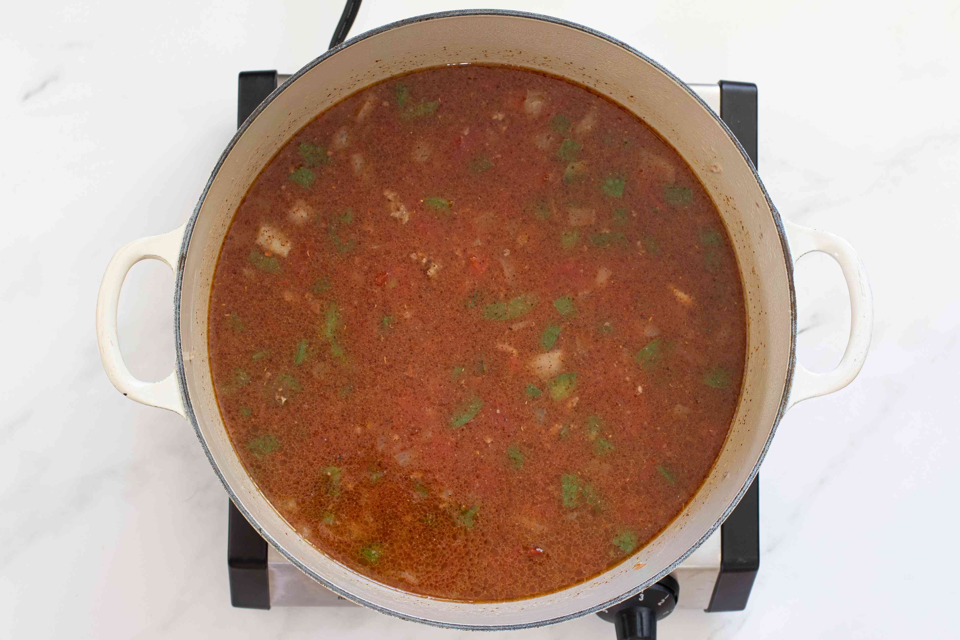 Simmer with tomatoes and spices