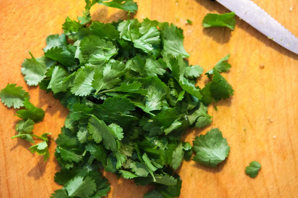 Cilantro leaves on a cutting board
