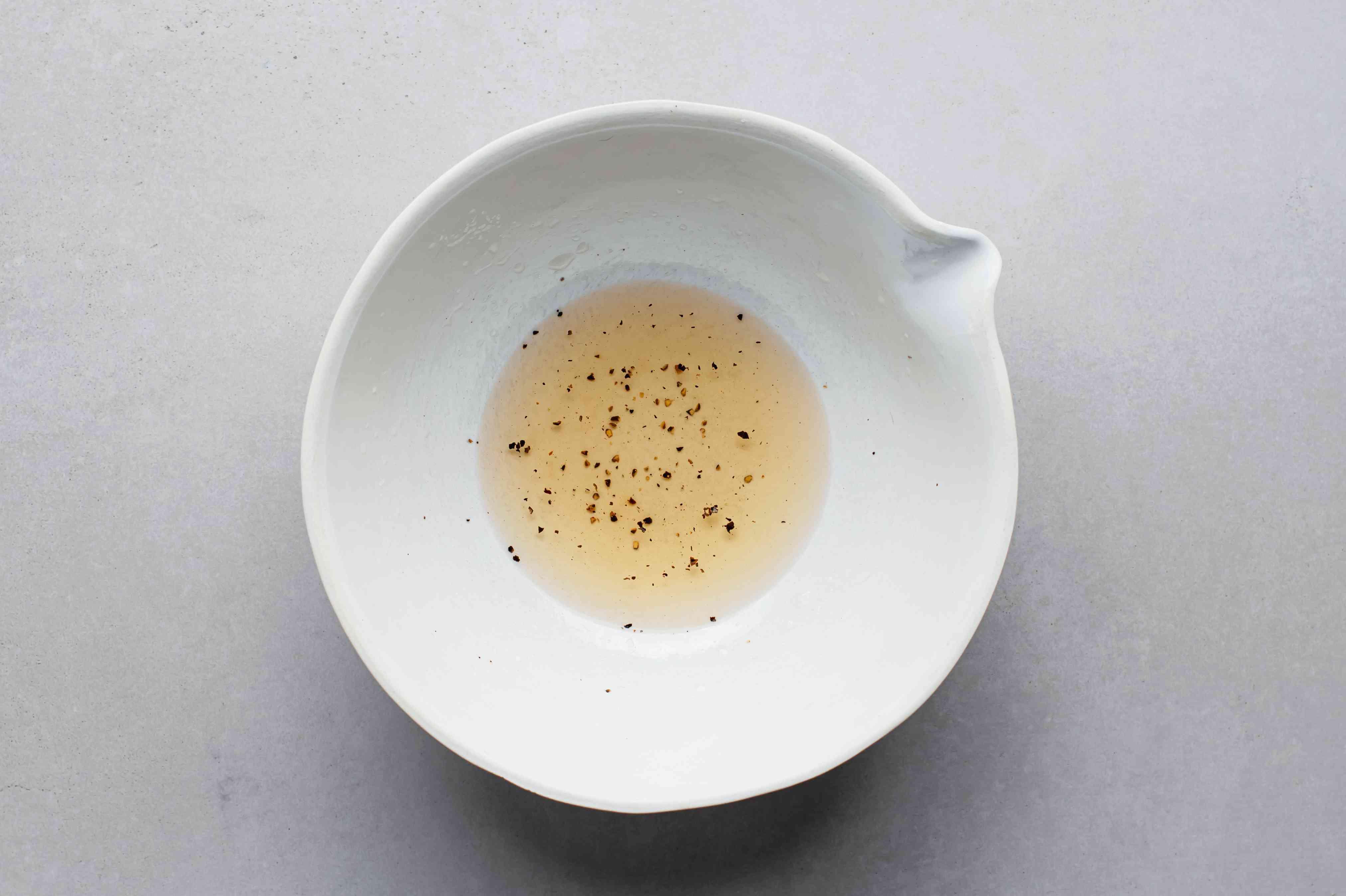 Vinegar, sugar, salt, and pepper in a serving bowl