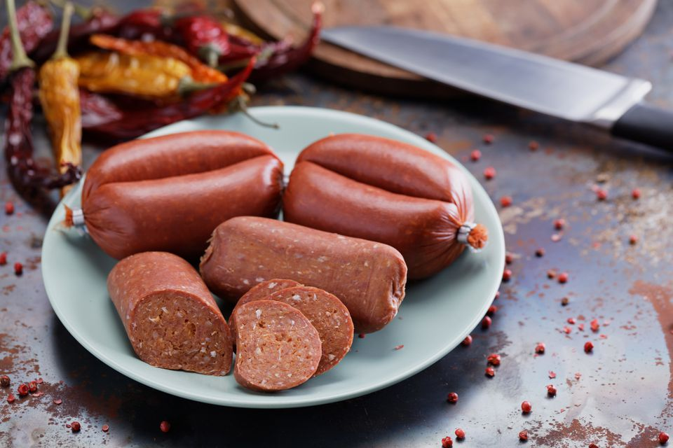 Turkish sausages sucuk (whole and slices) and spices