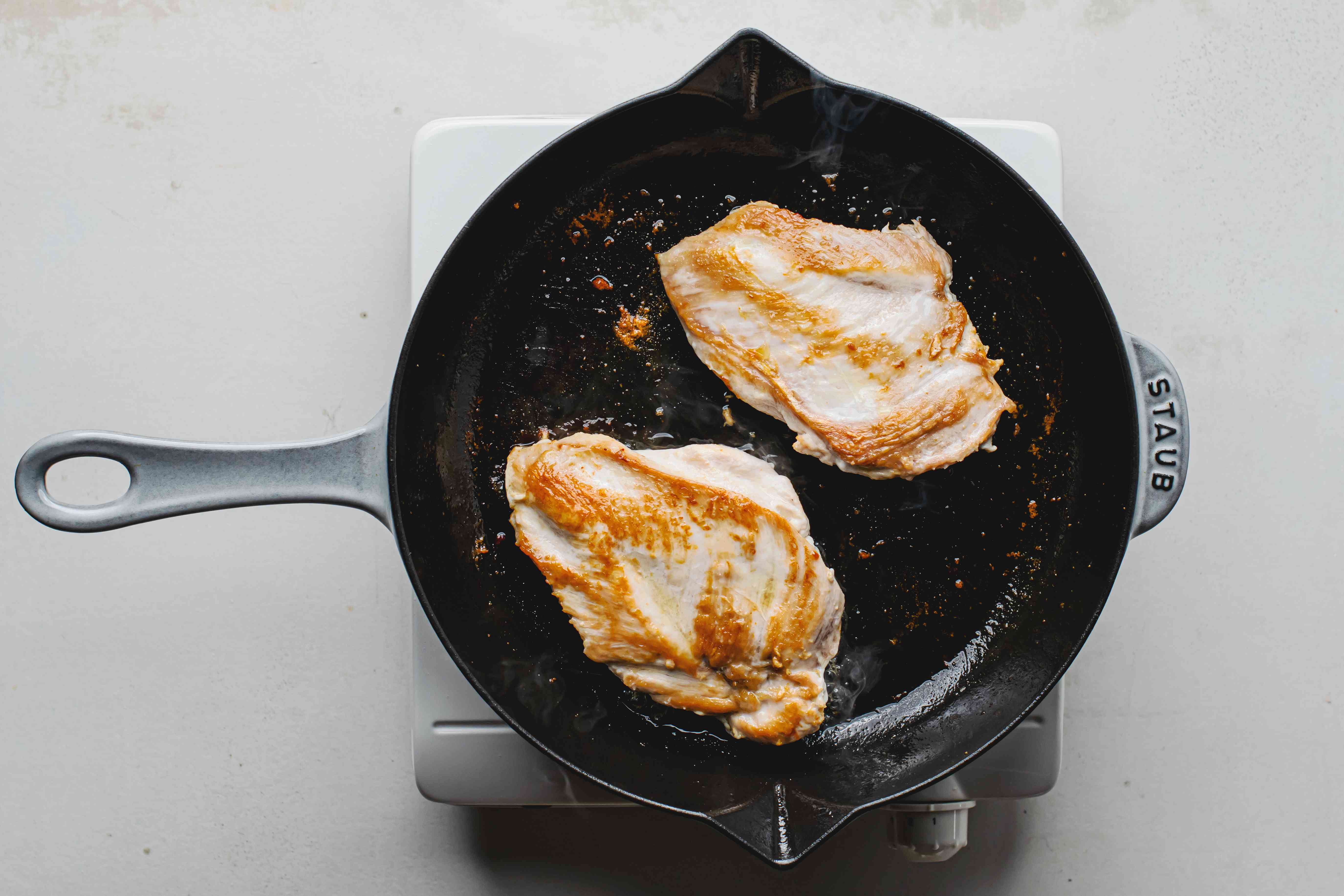 Pan-fried chicken in a cast-iron skillet